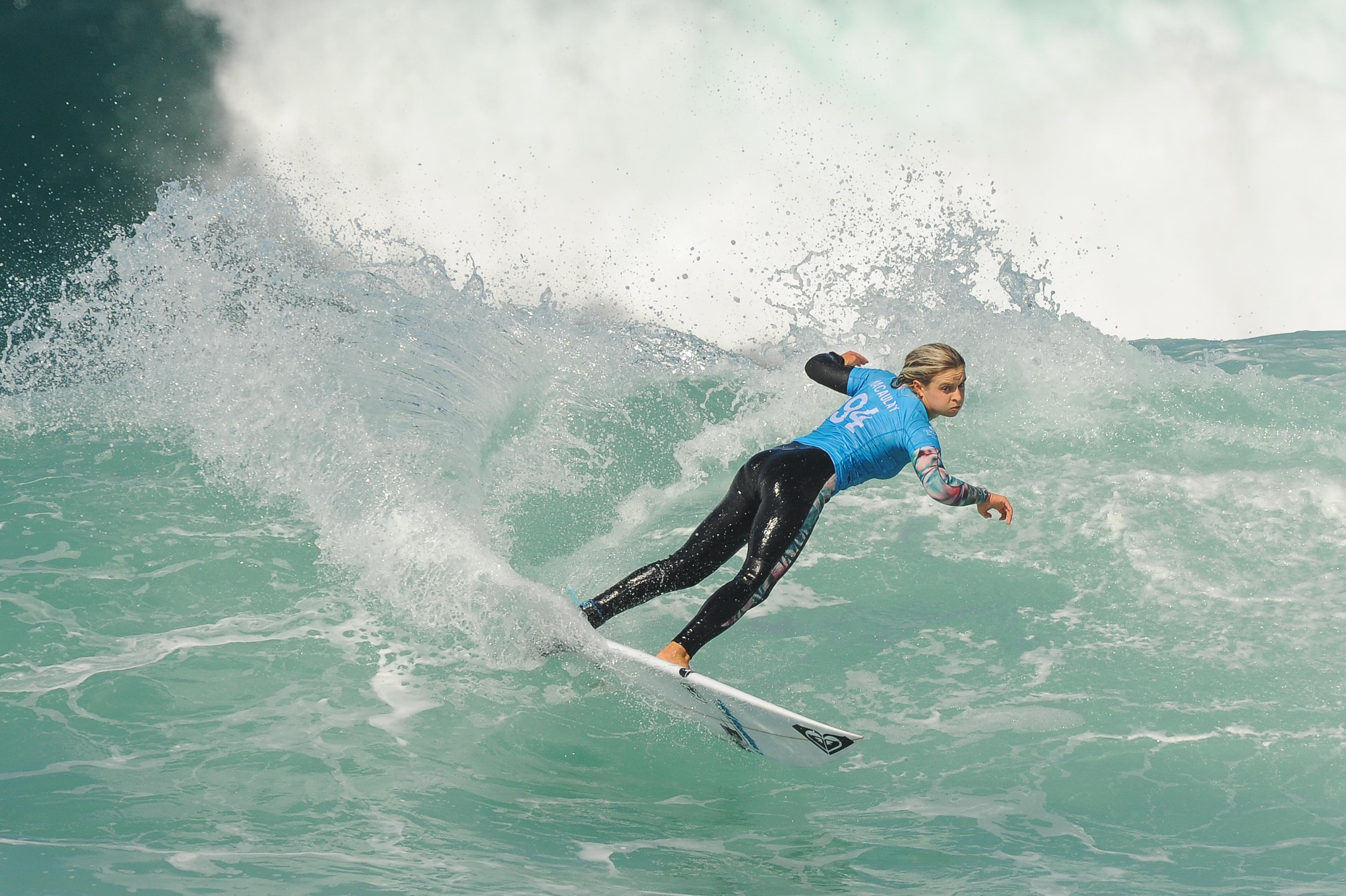 Some surfers opt for trousers when riding the waves