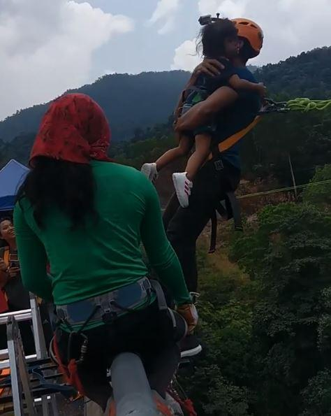 Fury as reality TV star Redha Rozlan bungee jumps into 200ft ravine clutching his two-year-old daughter without a helmet