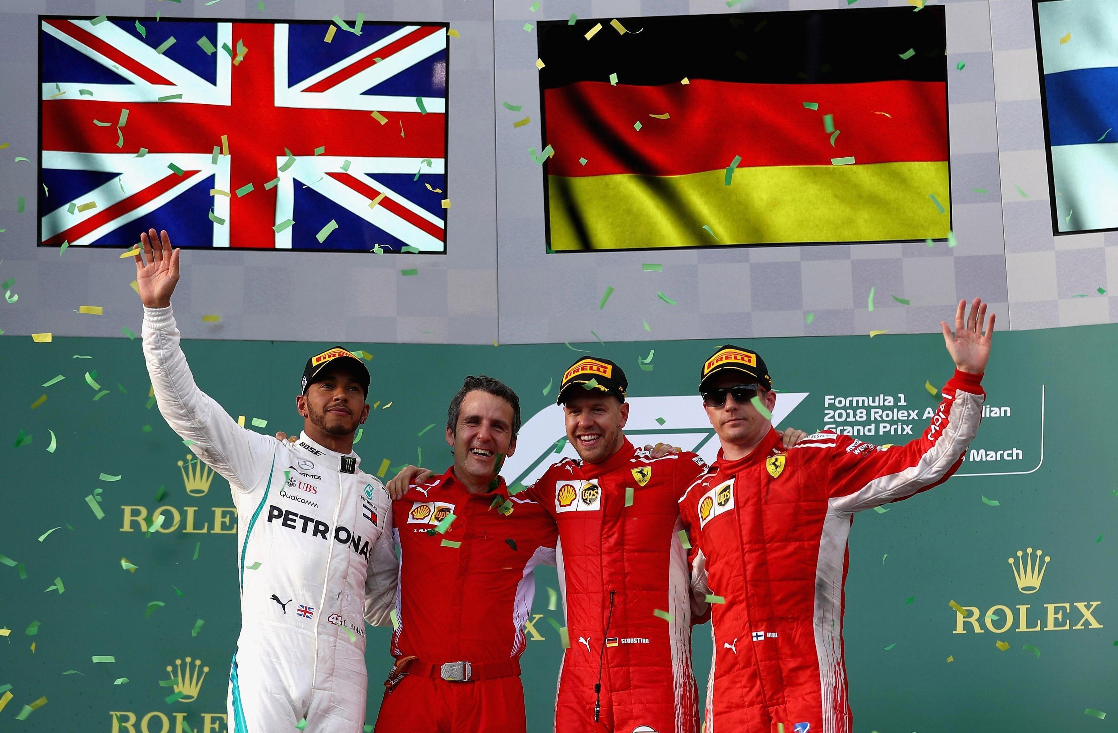 Top three Lewis Hamilton, Kimi Raikkonen, Sebastian Vettel celebrate on podium