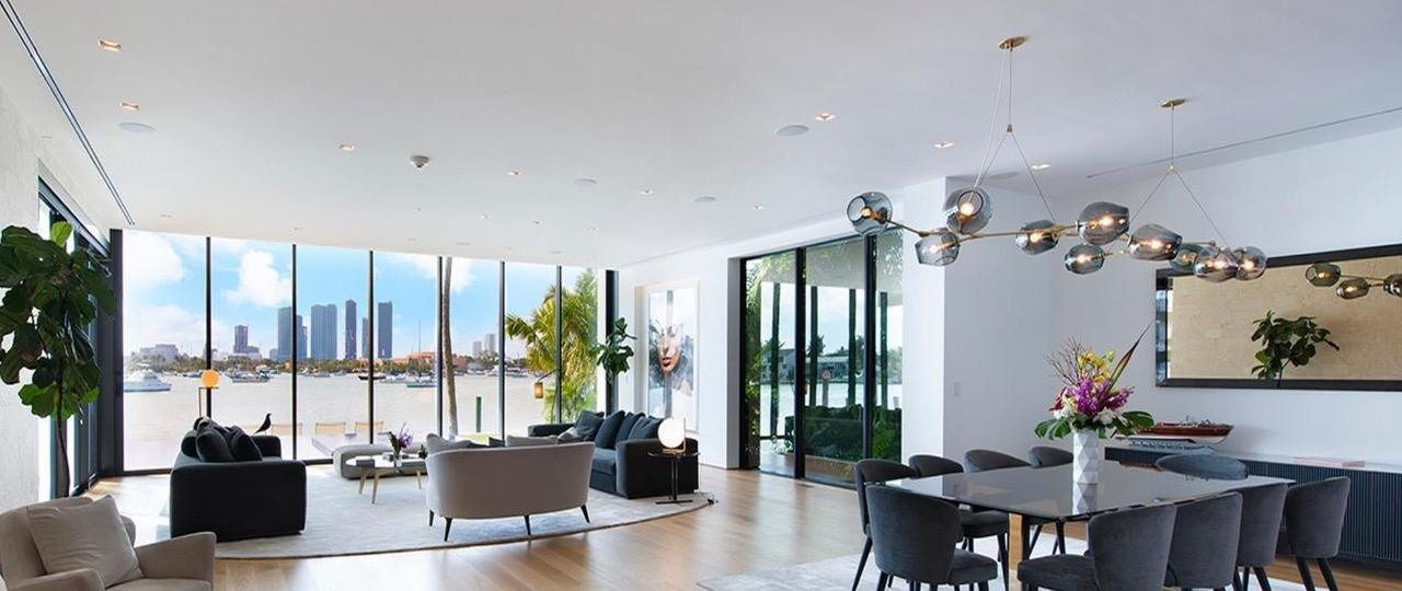 Inside the furnishings are tastefully arranged with uber-modern lighting over a dining table