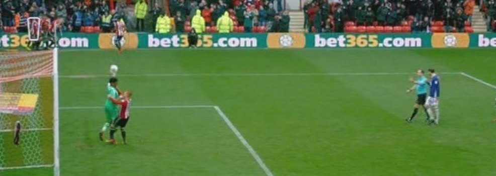Bees midfielder Woods then comes around Blackman and appears to grab his neck