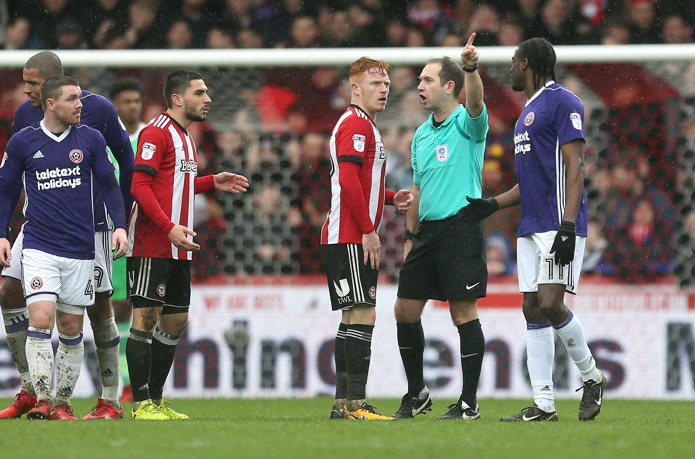 Ryan Woods is sent off after his clash with Jamal Blackman