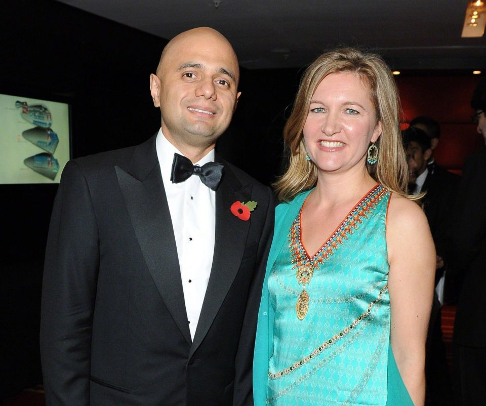 Mr Javid with wife Laura at a black-tie awards do in 2014