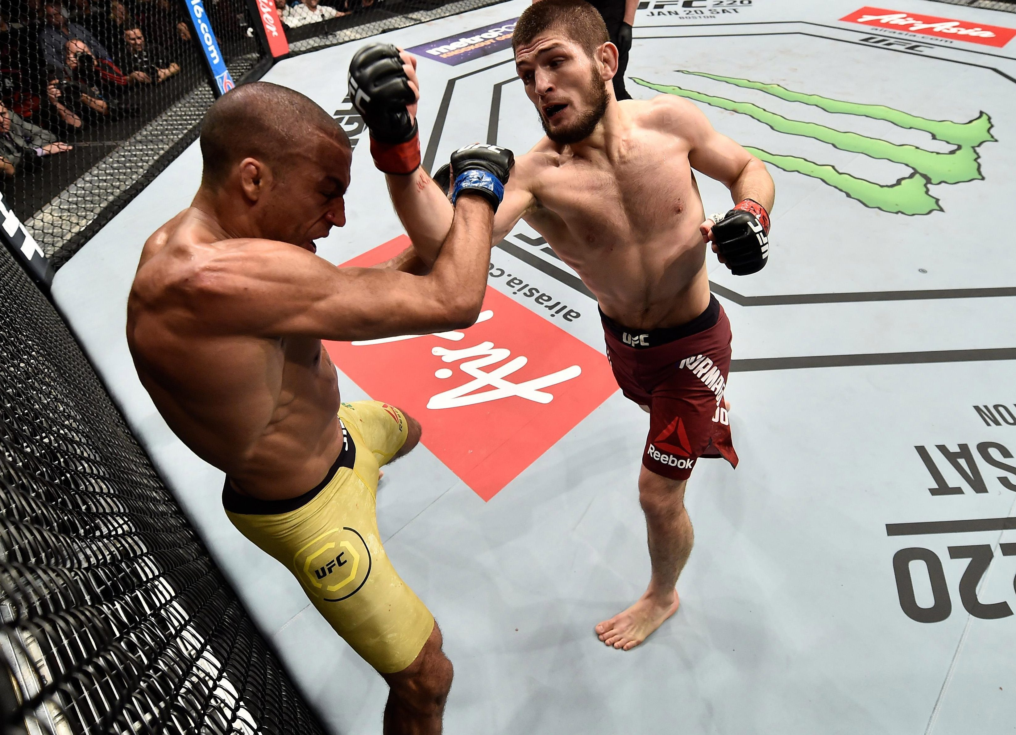 Russian star Khabib Nurmagomedov punches Brazilian Edson Barboza in their lightweight bout at UFC 219 - but is also hitting out verbally away from the ring