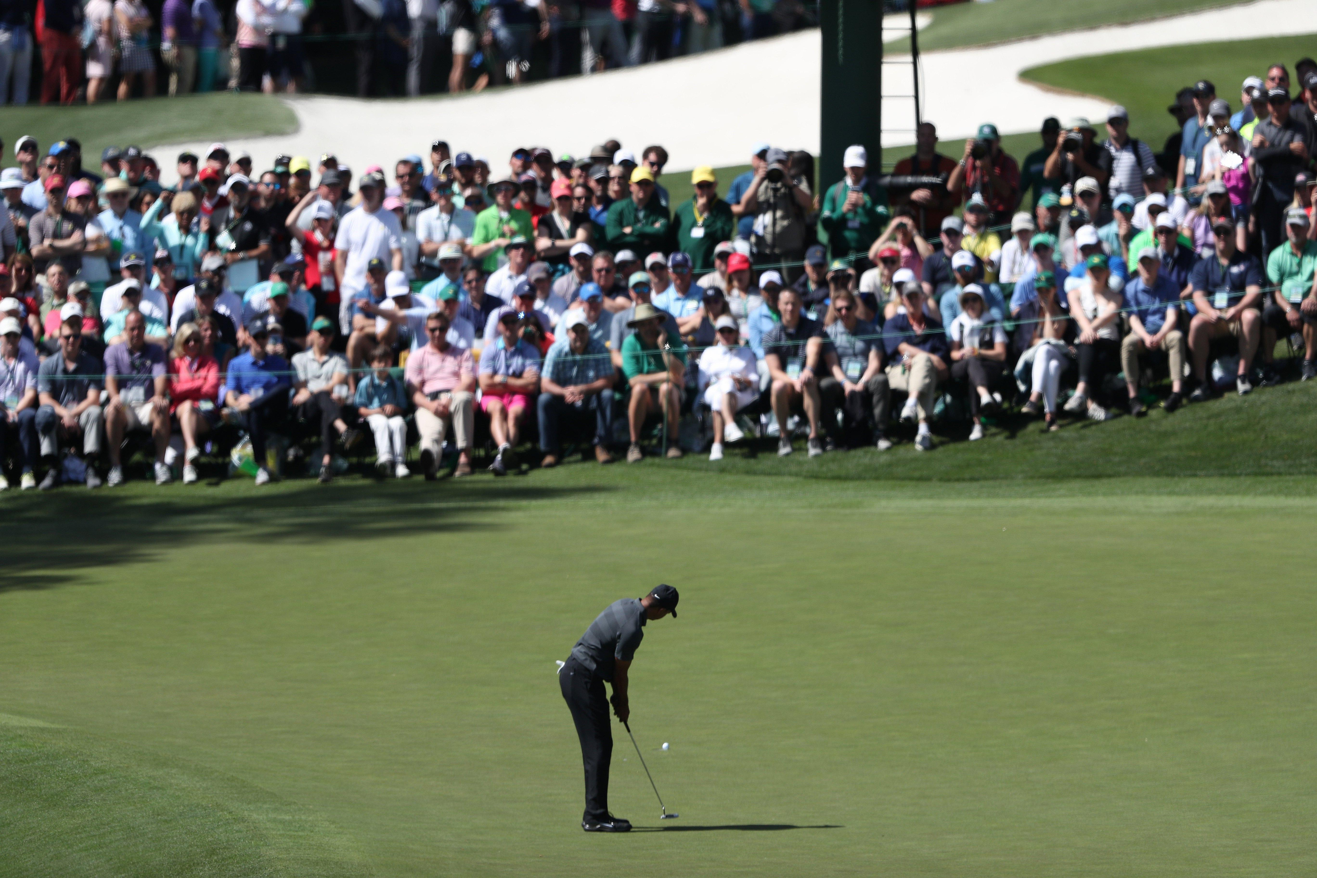 Four-time Masters winner Tiger Woods still draws a crowd at Augusta