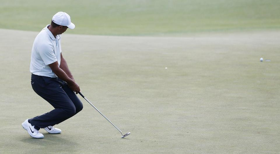 Tiger Woods made the cut after coming agonisingly close to missing the weekend
