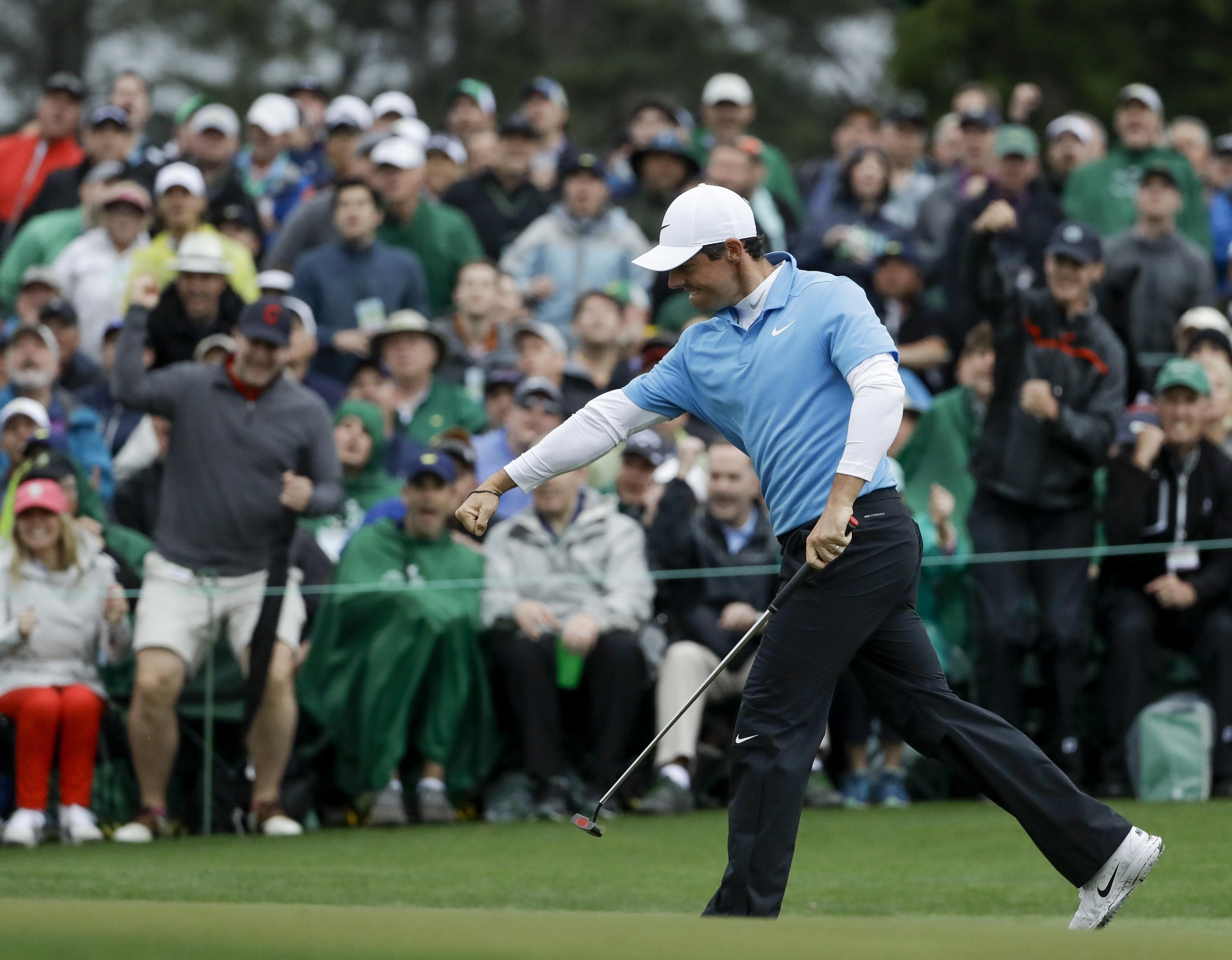 Rory McIlroy holes his birdie putt at the 18th on Saturday