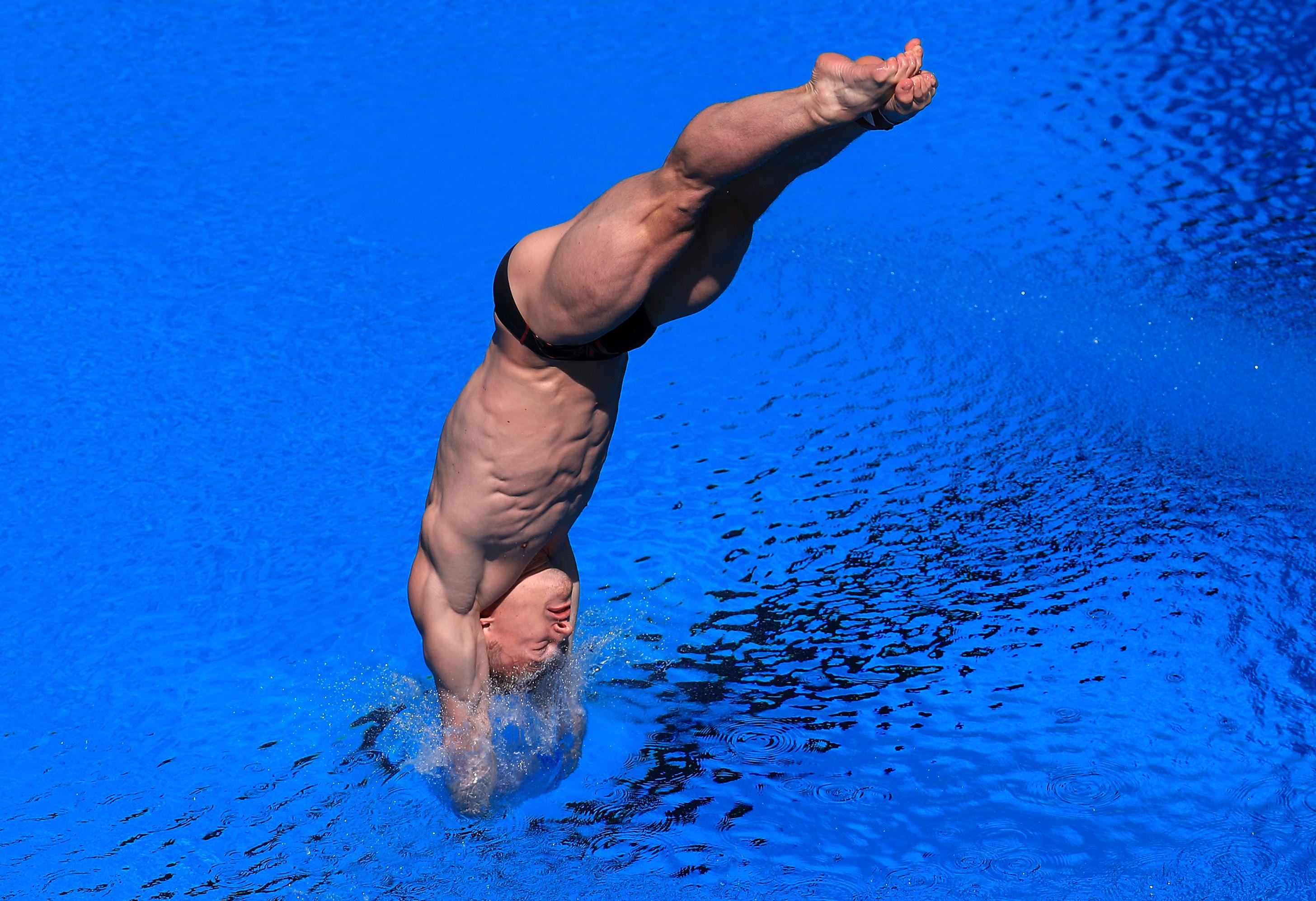 Laugher enters the water on one of his gold medal-winning dives