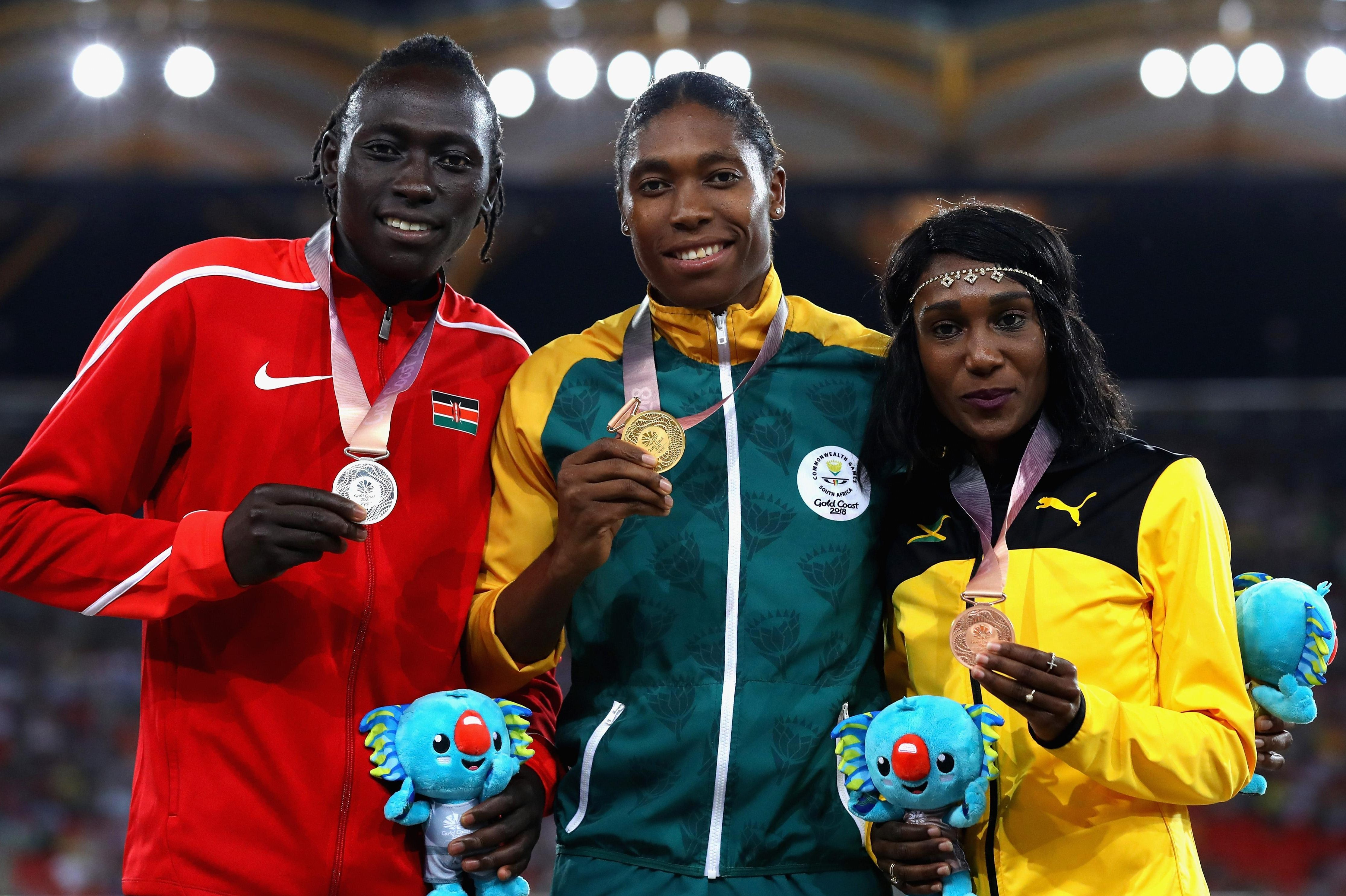 Caster Semenya (middle) brims with delight after scooping the 800m gold medal