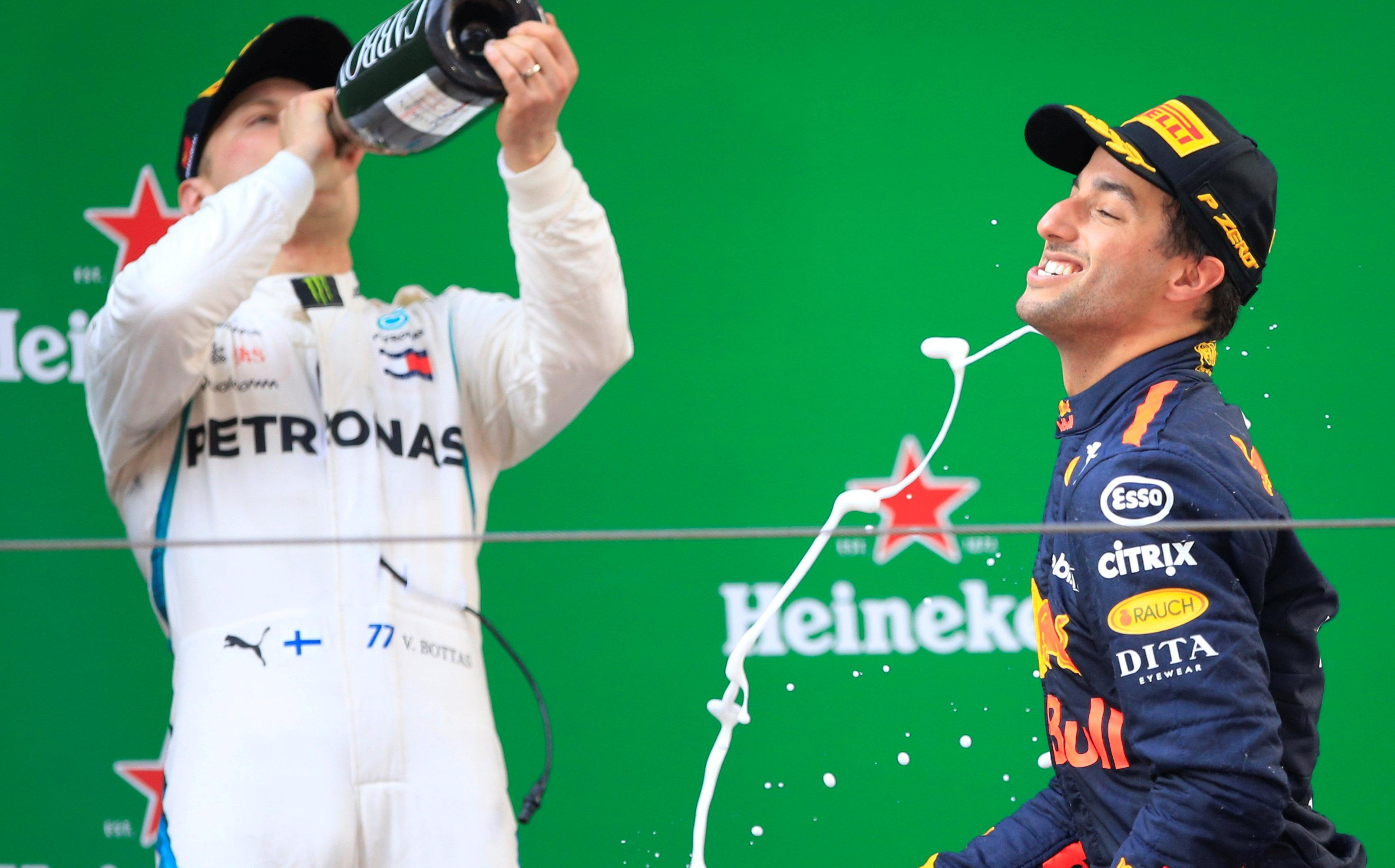 Daniel Ricciardo and Valtteri Botas on podium after Chinese GP