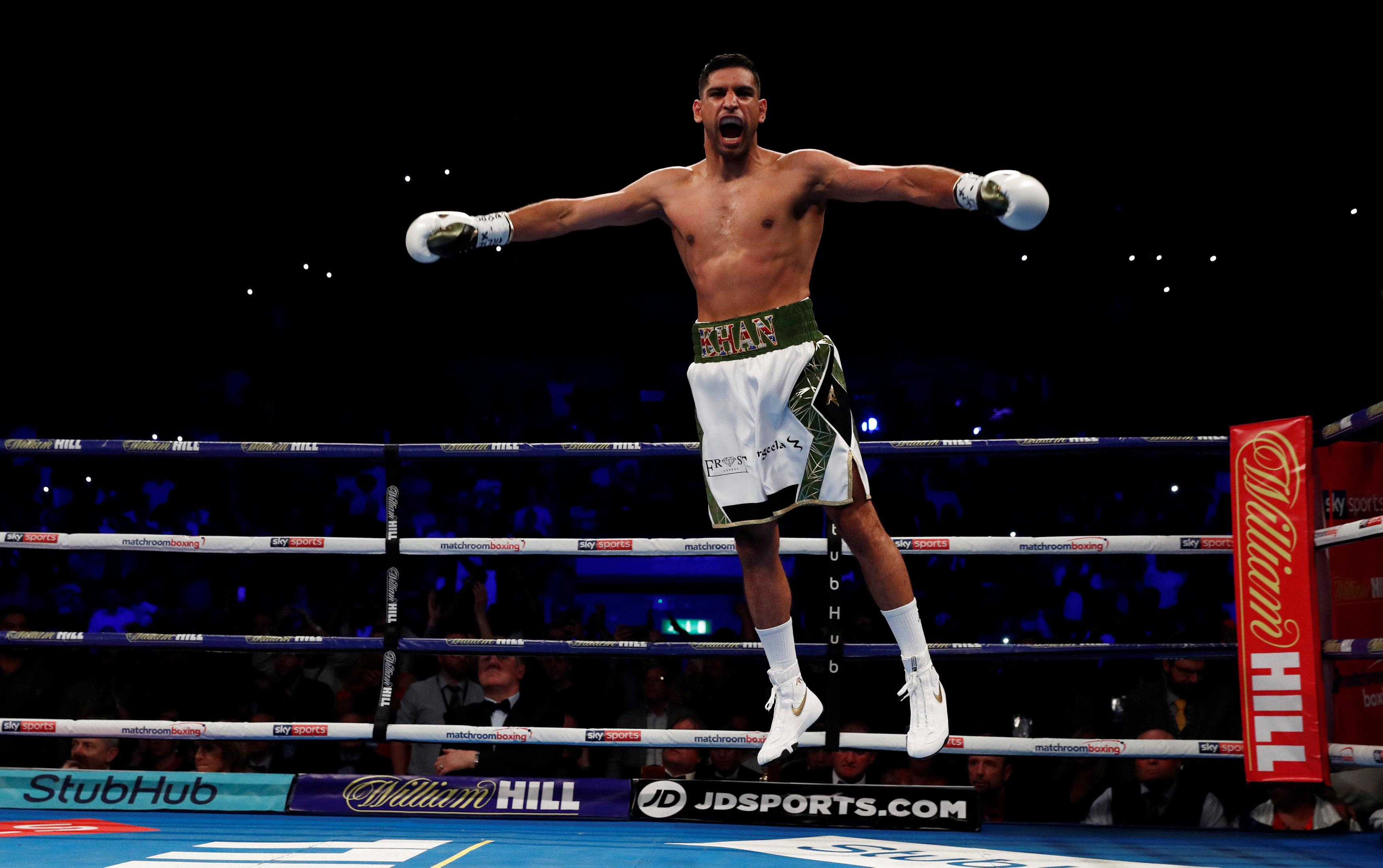 Amir Khan jumps for joy after his victory inside 40 seconds
