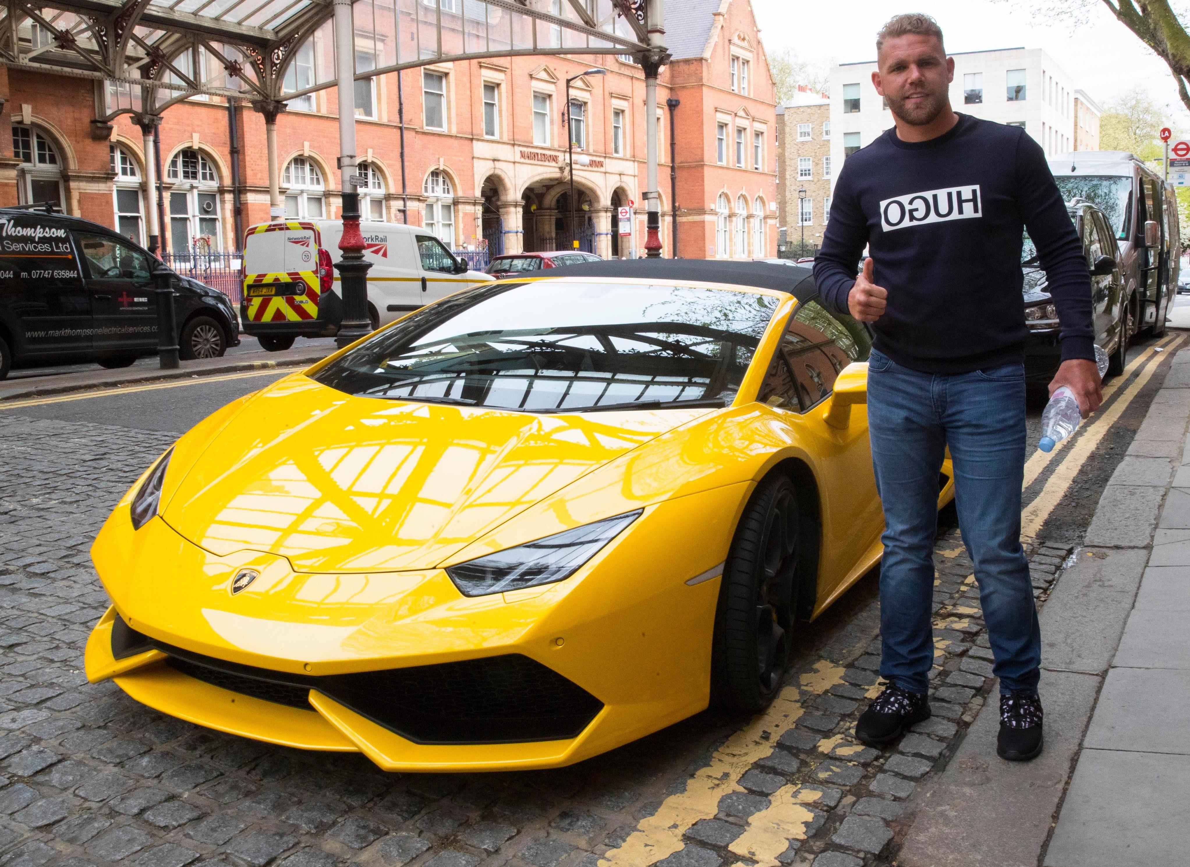 Billy Joe Saunders gives a thumbs up as he picks up his Lamborghini outside Marylebone station