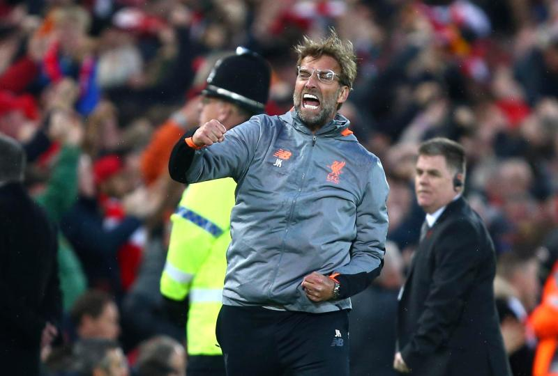 Jurgen Klopp pumps his arms in celebration as Liverpool smash five past Roma at Anfield