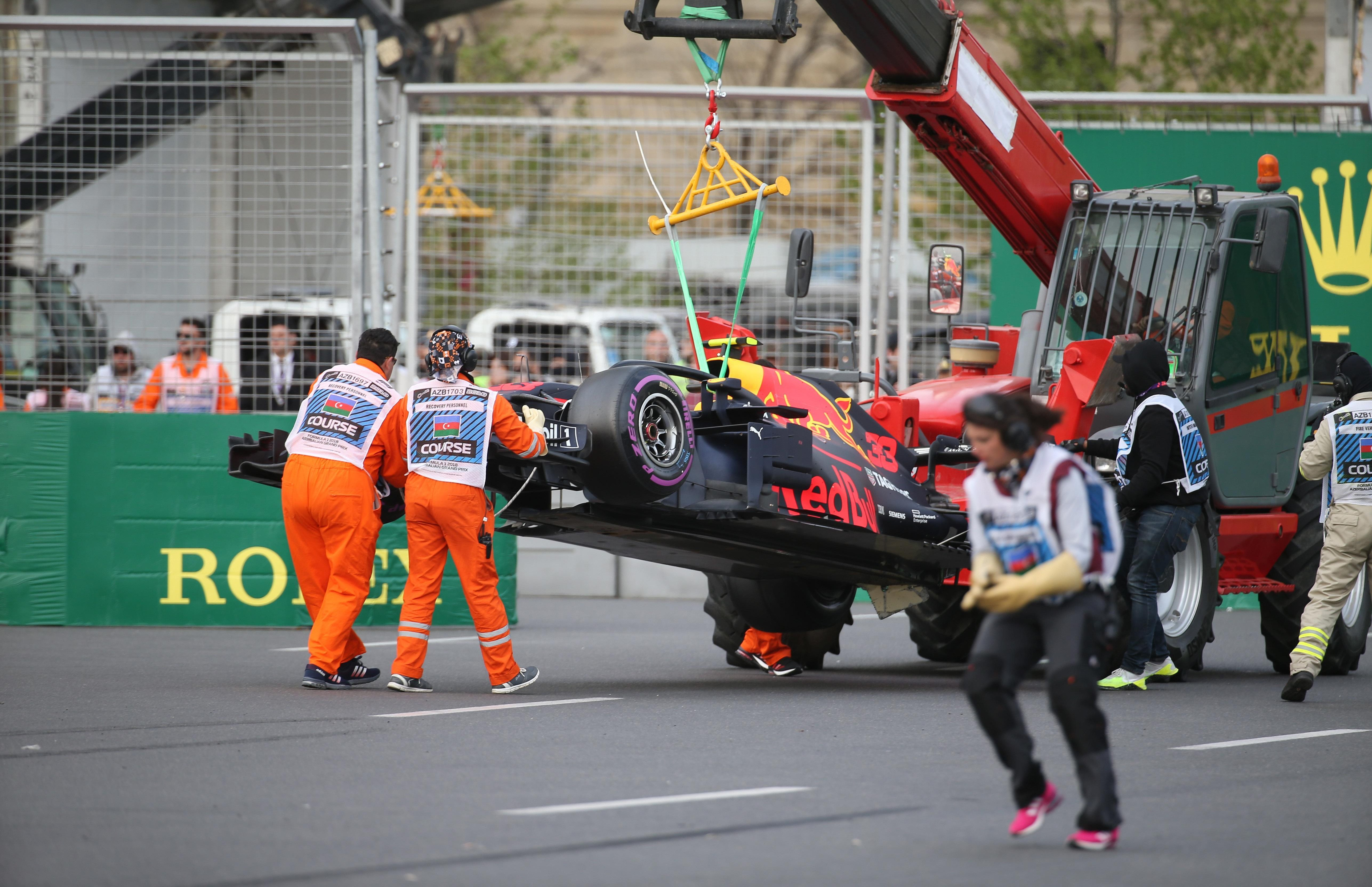 The crashed car of Max Verstappen is taken away during the Azerbaijan GP