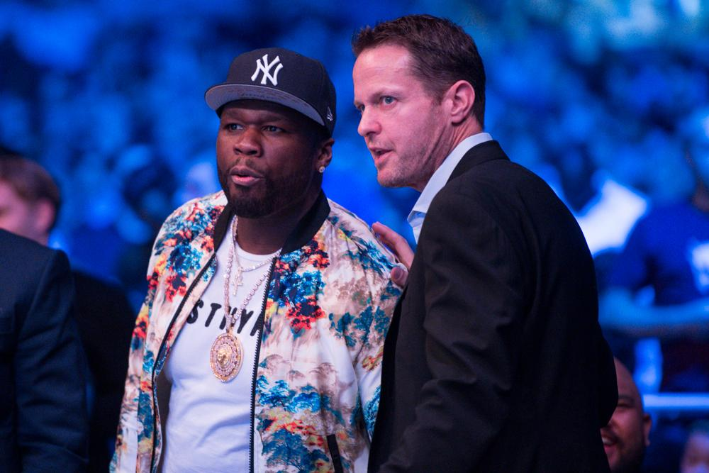 The hip-hop legend looked eager to be by the side of the cage ahead of the night's action