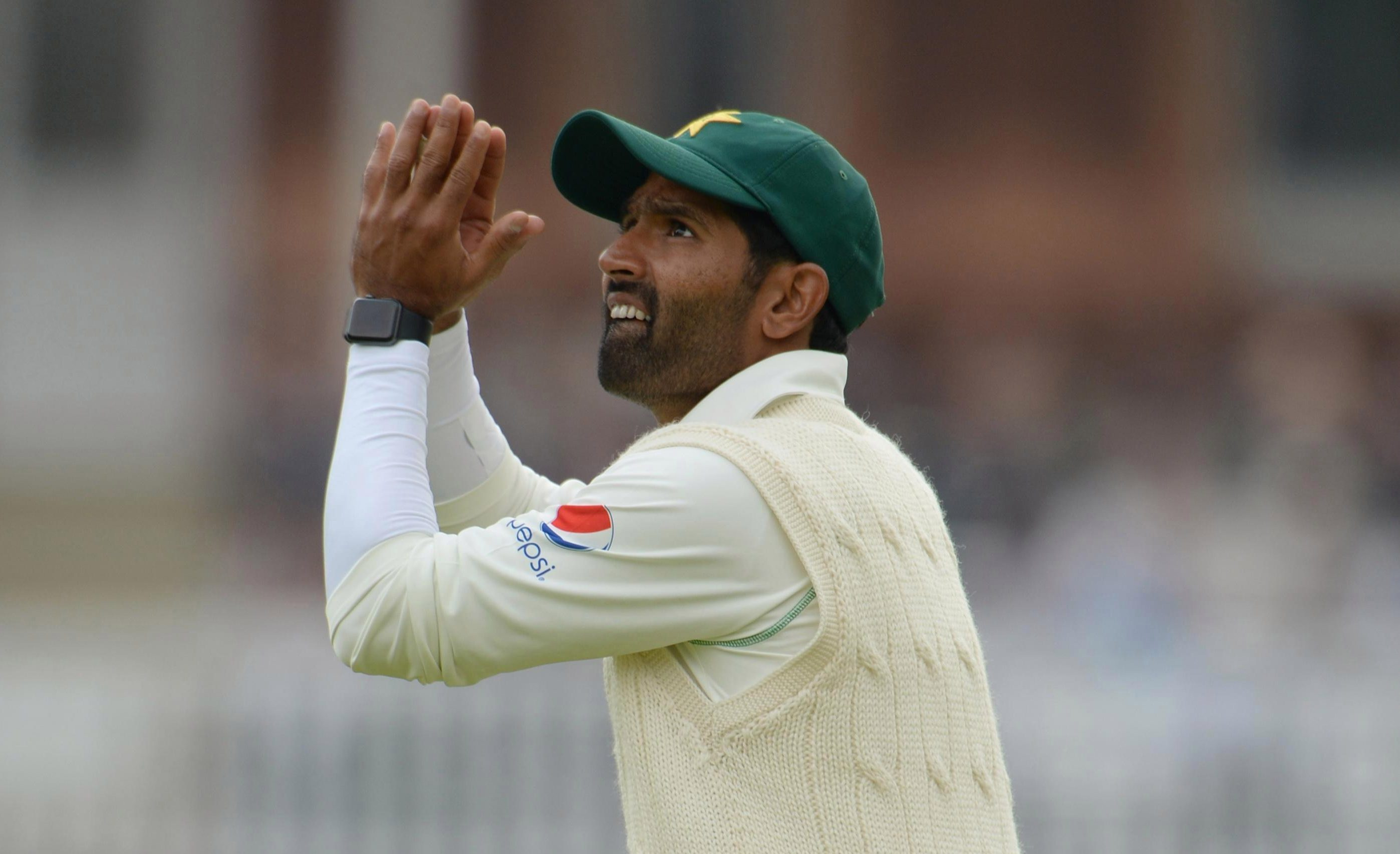 Asad Shafiq was seen wearing what looked like an Apple watch or similar smart device on his wrist