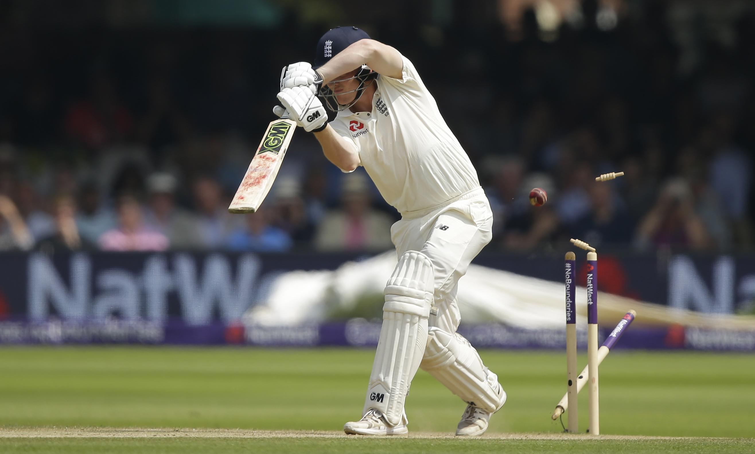 Dominic Bess sees his wicket shattered as England crashed to 242 all-out