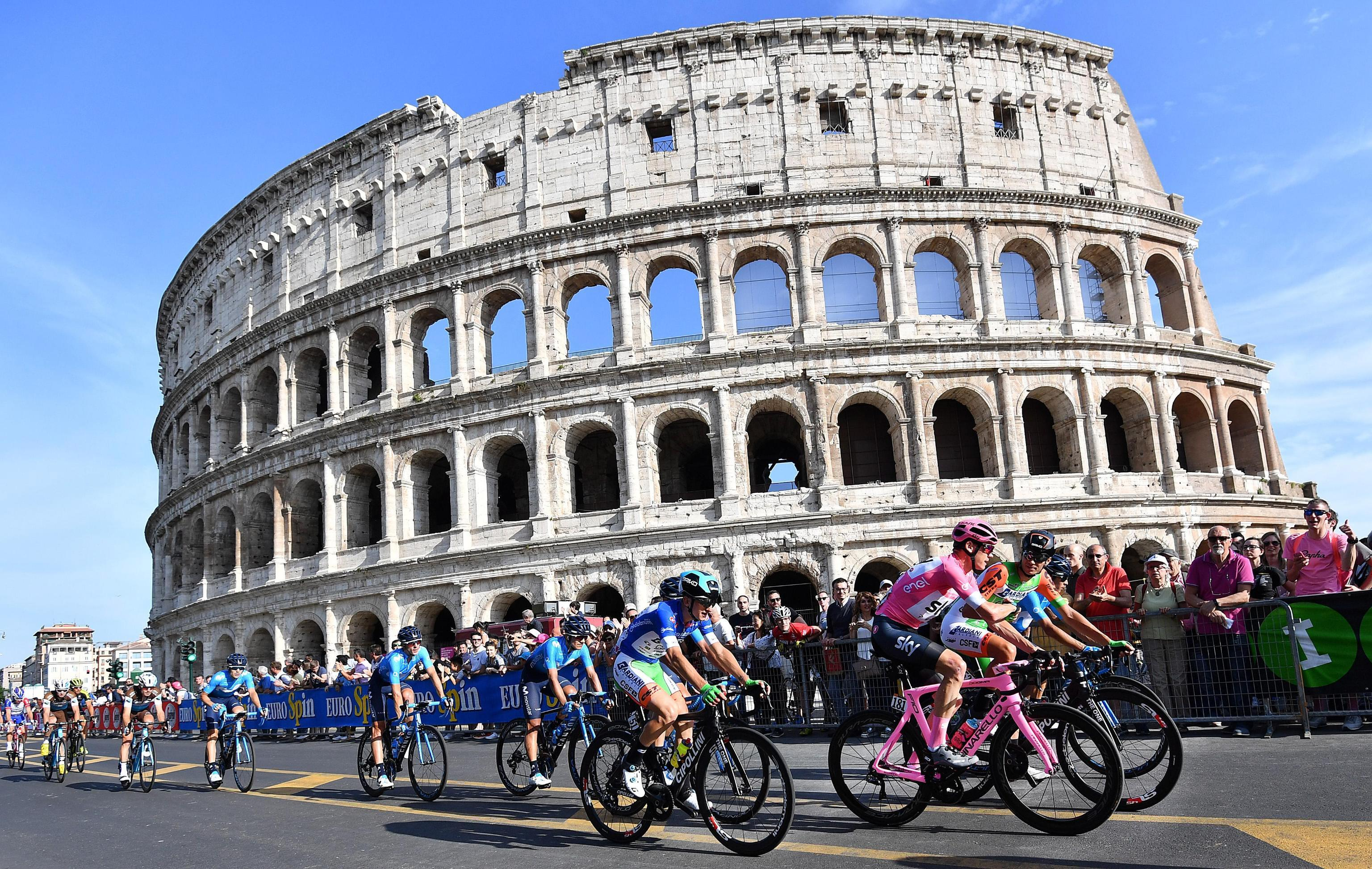 Froome rides past the Colosseum on the procession final stage of the Giro in Rome