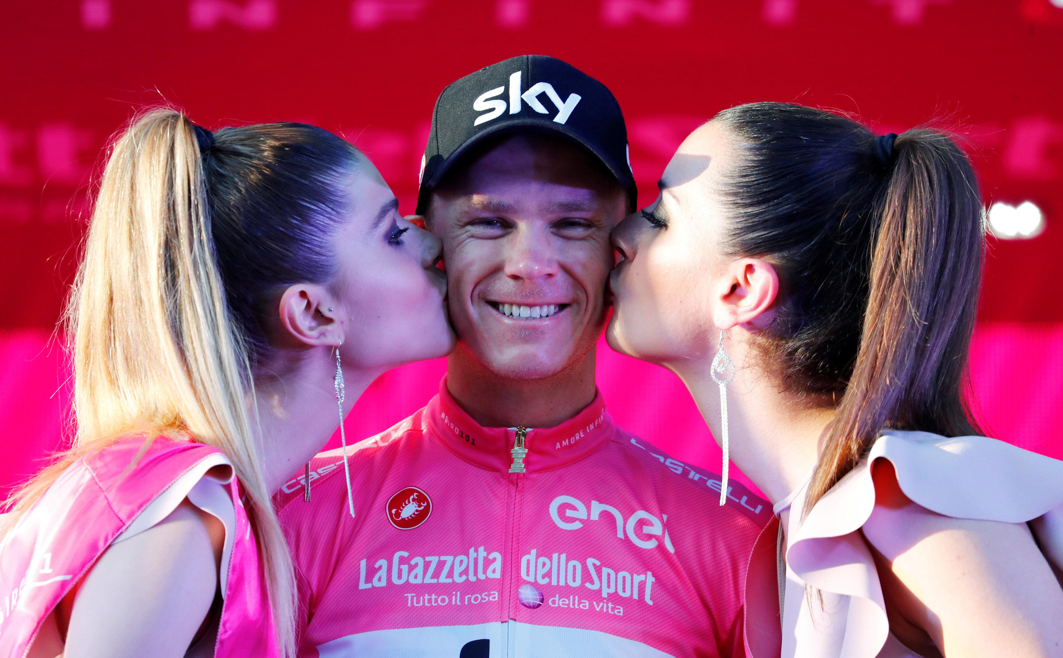 Froome is all smiles on the podium and the British rider is now in possession of all three Grand Tours