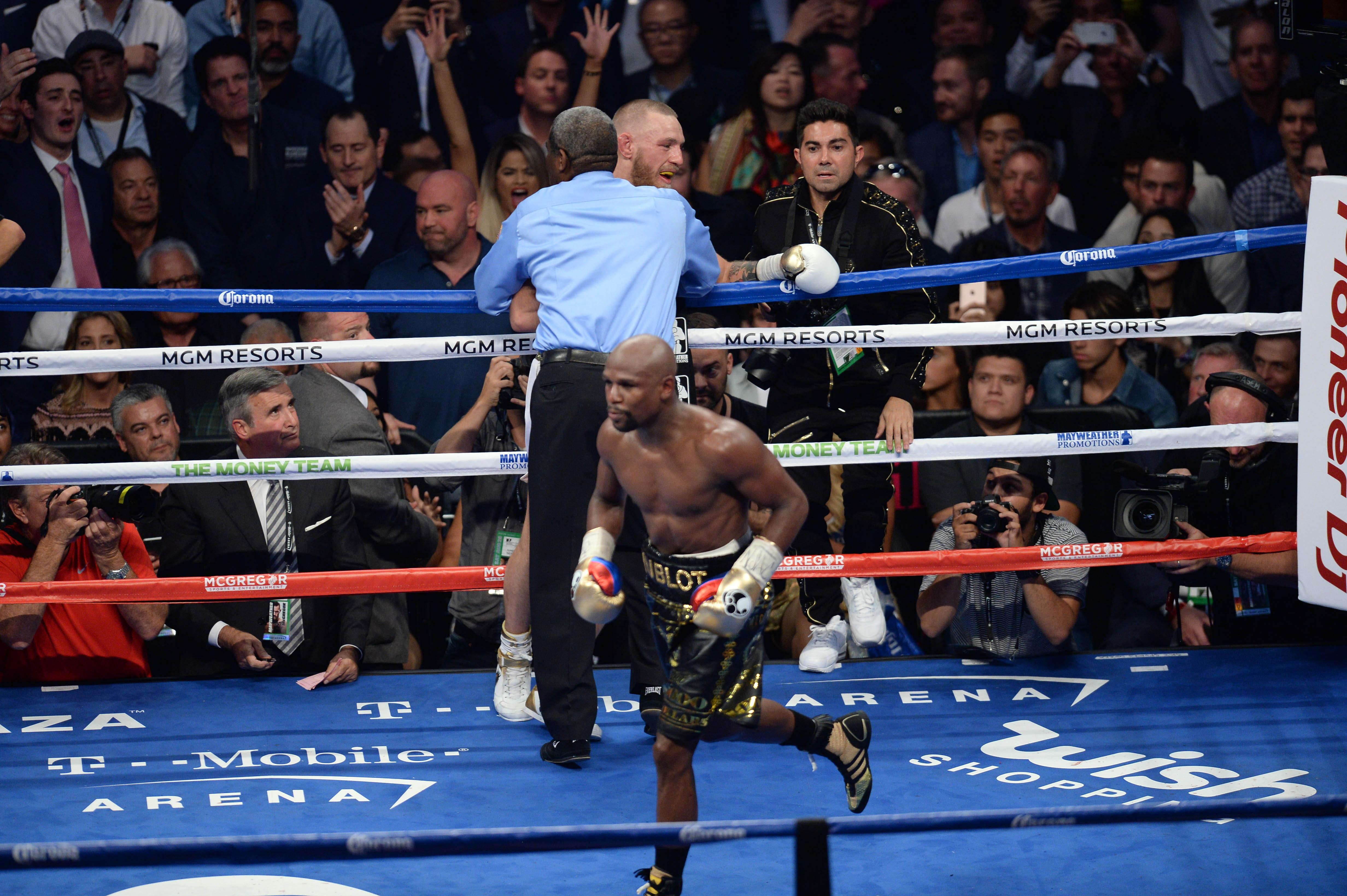 Former five-weight world champion Mayweather celebrates after extending his record to 50-0