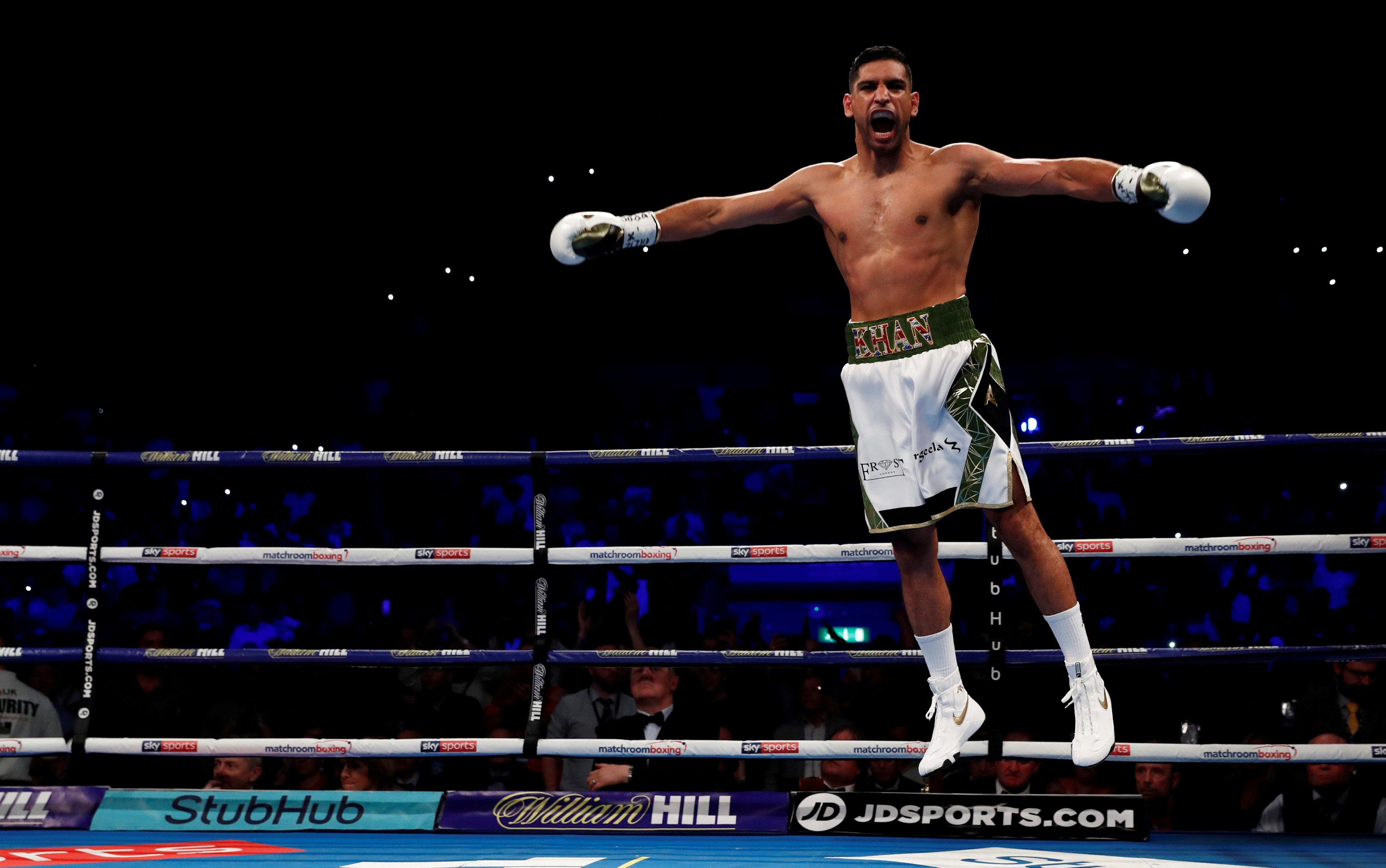 Amir Khan celebrates his comeback win over Phil Lo Greco