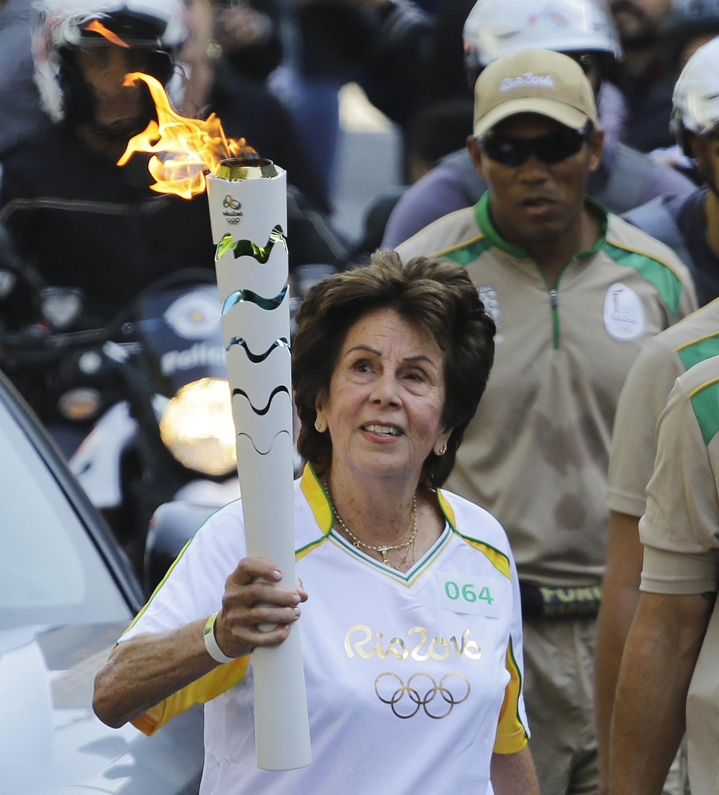 Bueno carried the Olympic torch ahead of the 2016 Games in Rio de Janeiro