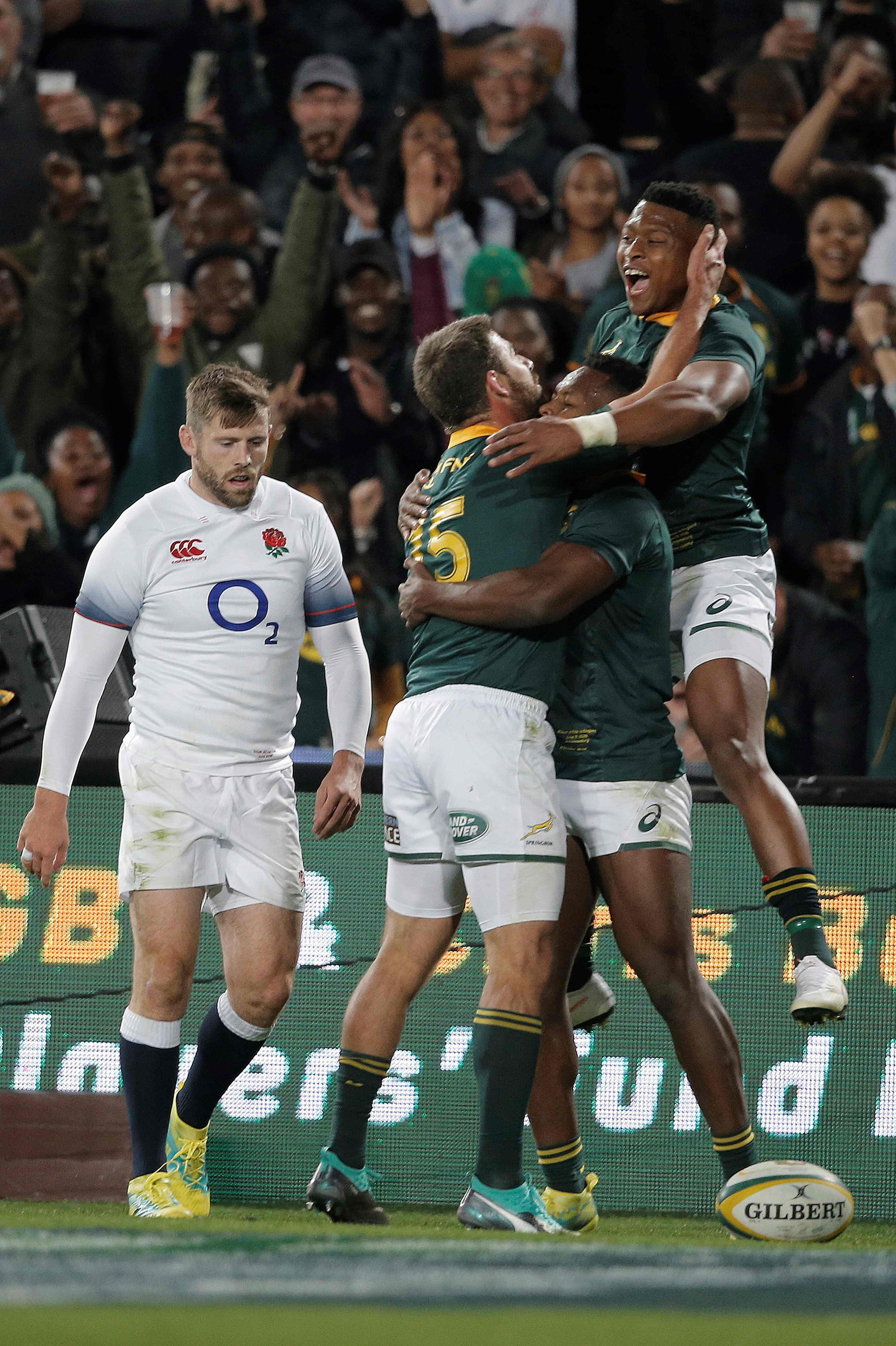 Nkosi celebrates with his team-mates after scoring a try for his country