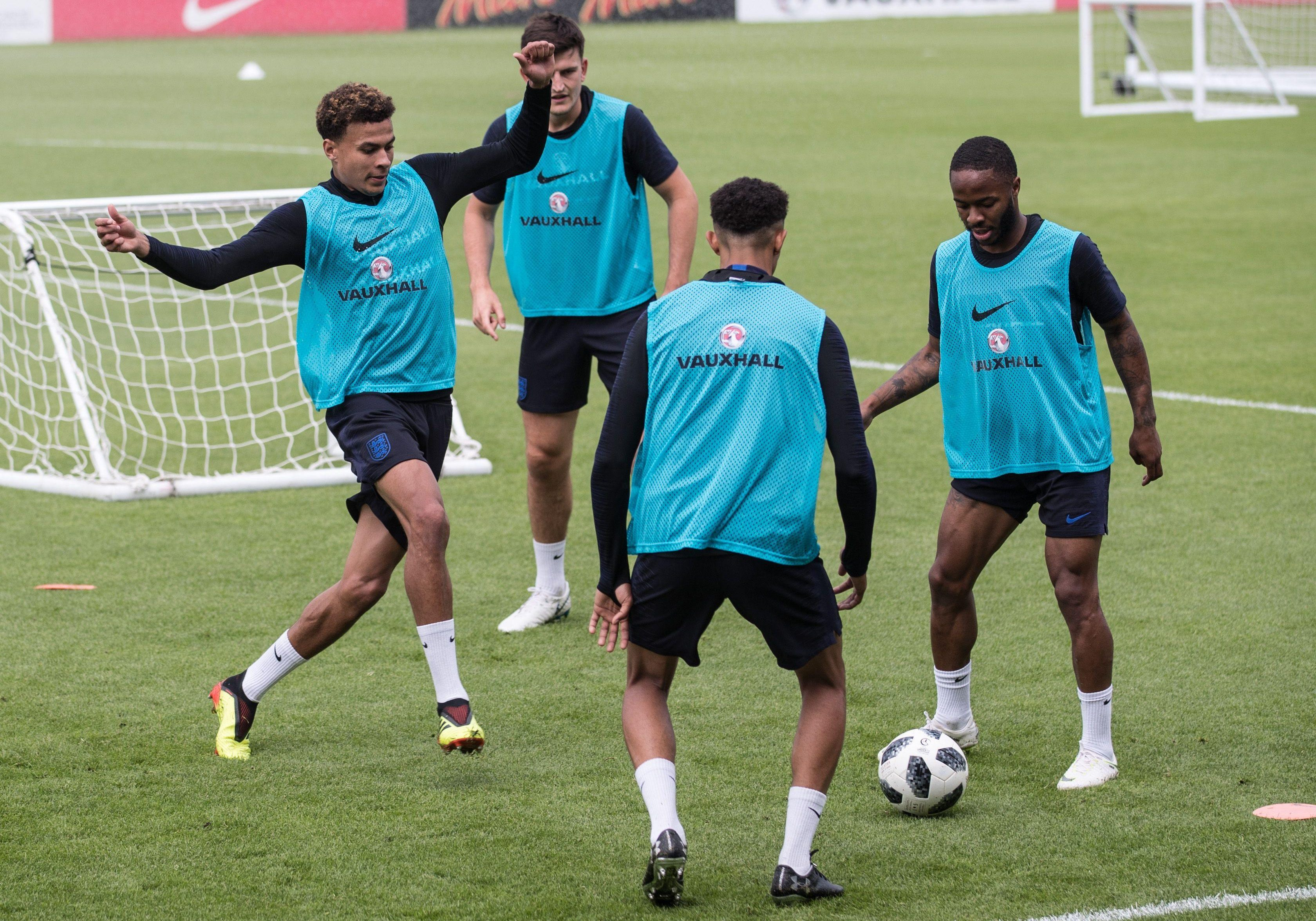 Dele Alli, Harry Maguire, Trent Alexander-Arnold and Raheem Sterling in action at St George's Park