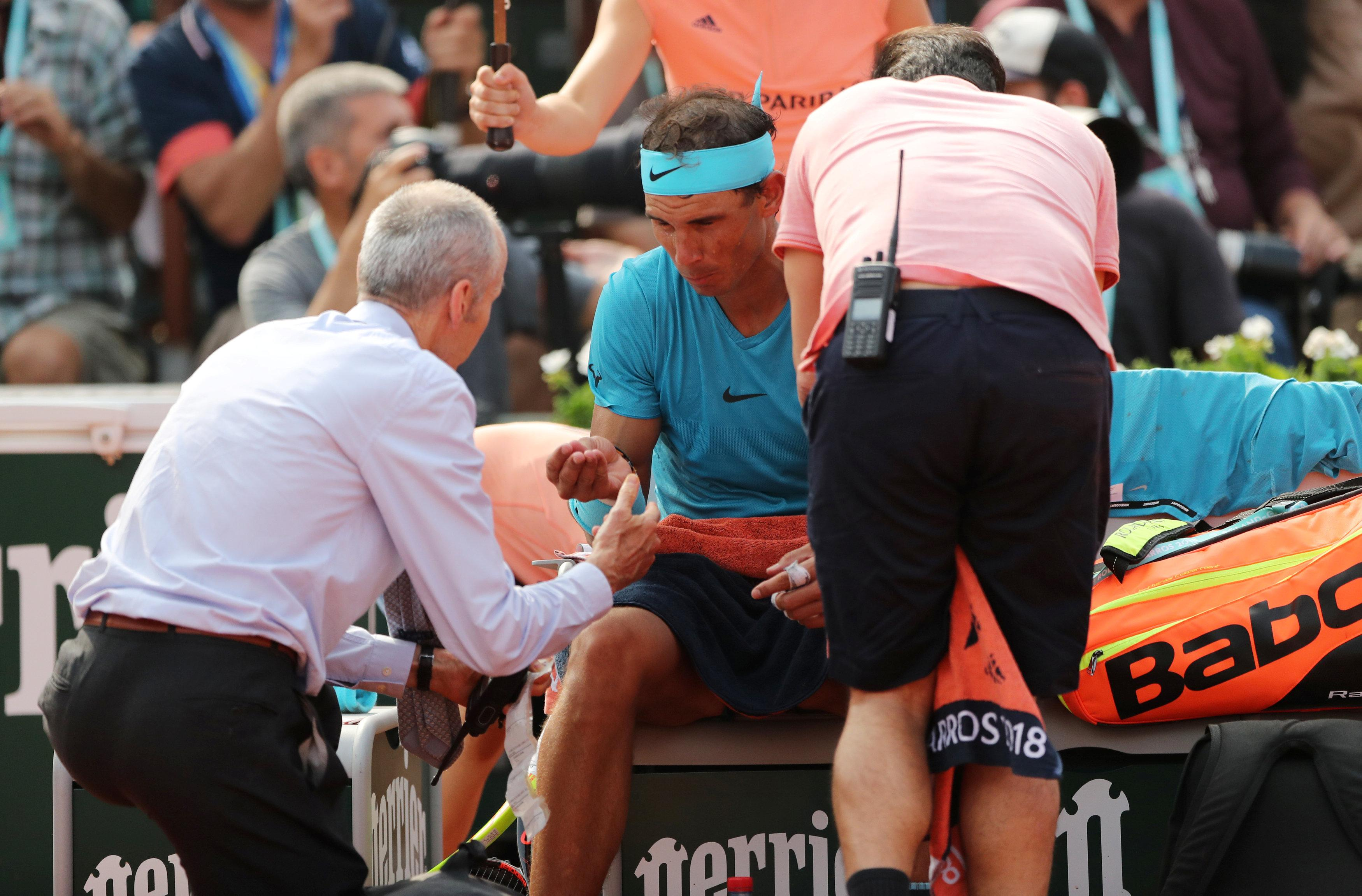 Nadal's game was impacted by cramp and he received treatment court side