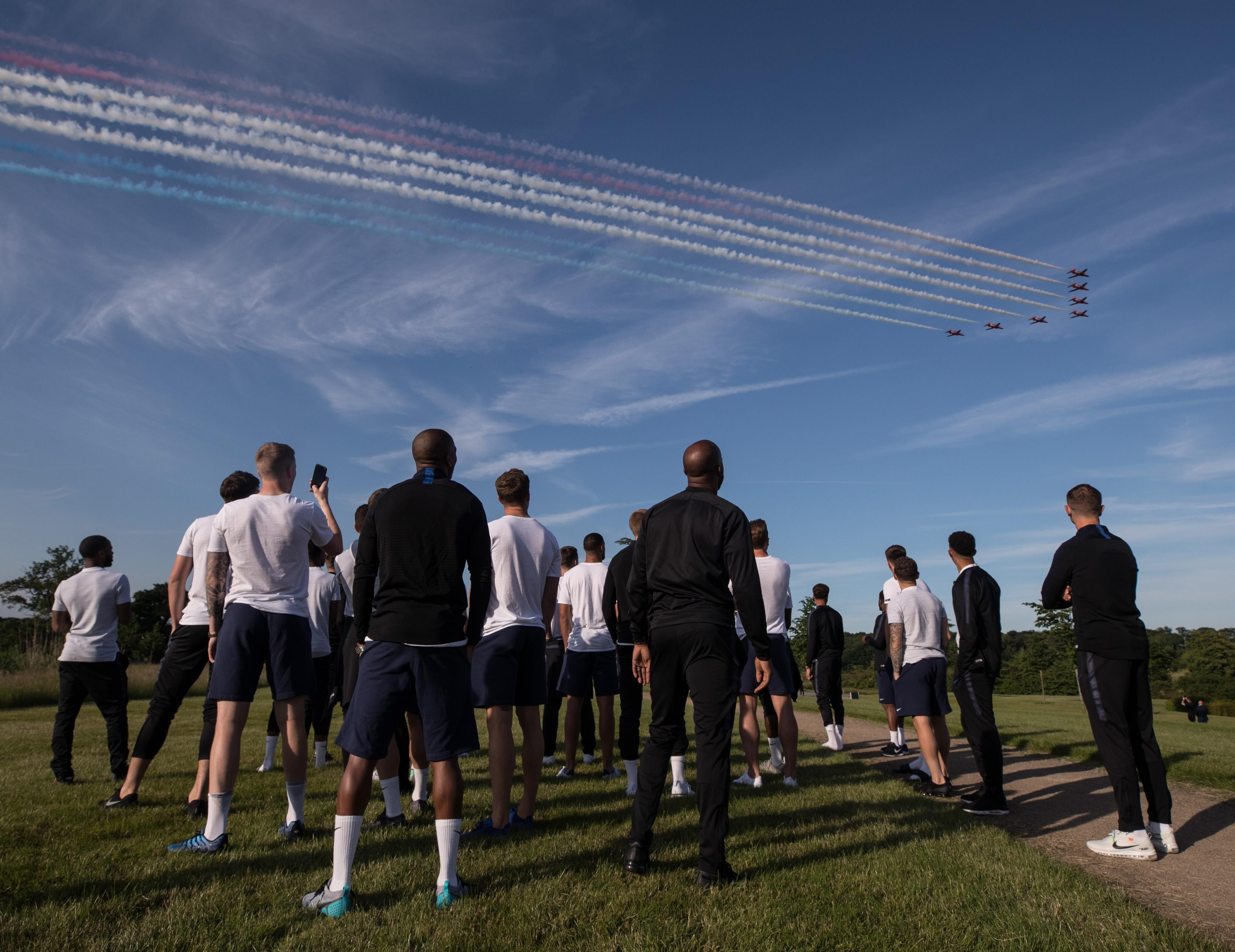 The players stood in awe as the planes put on a show above them