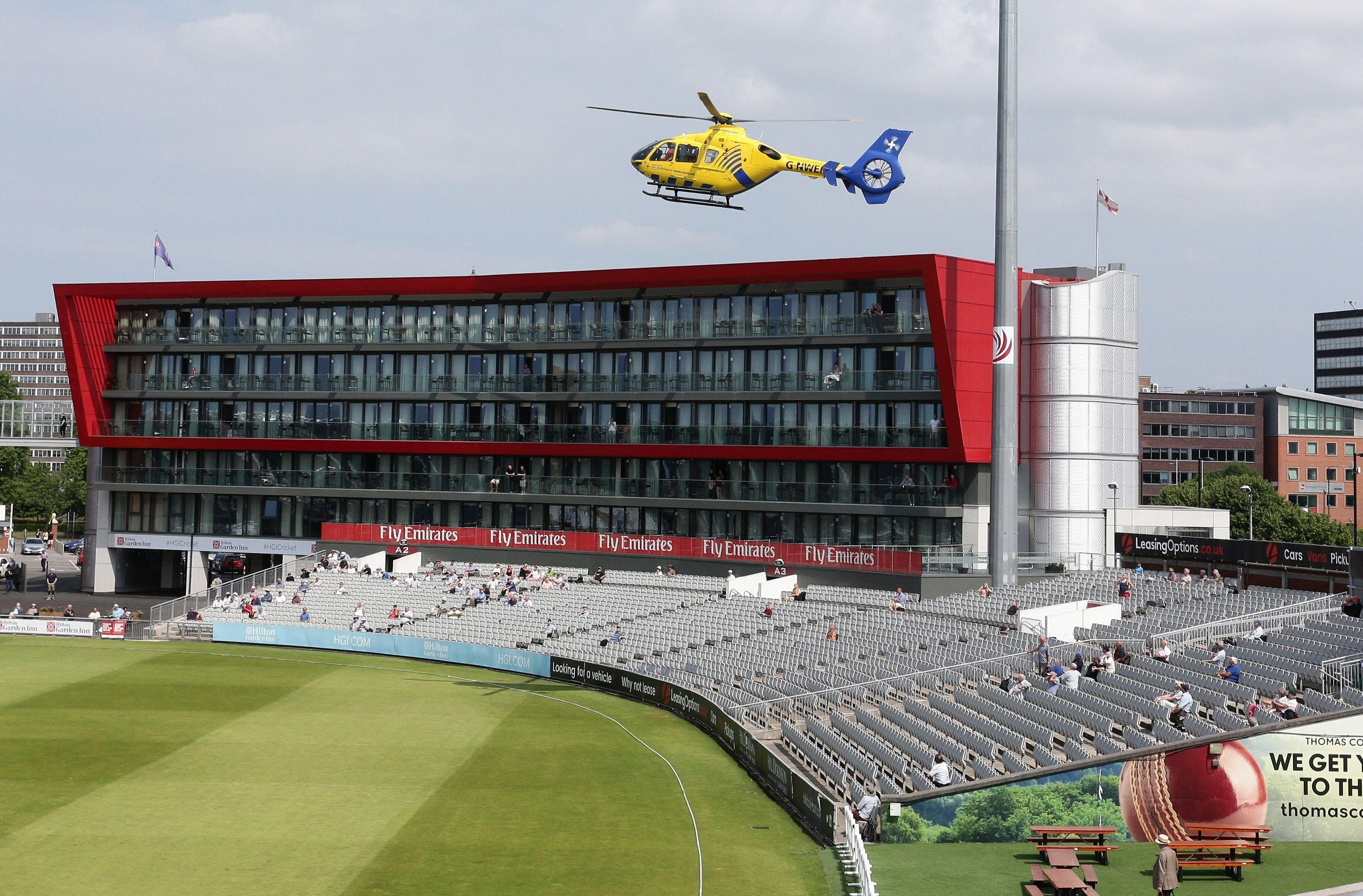 The air ambulance flew over the ground and landed on the pitch