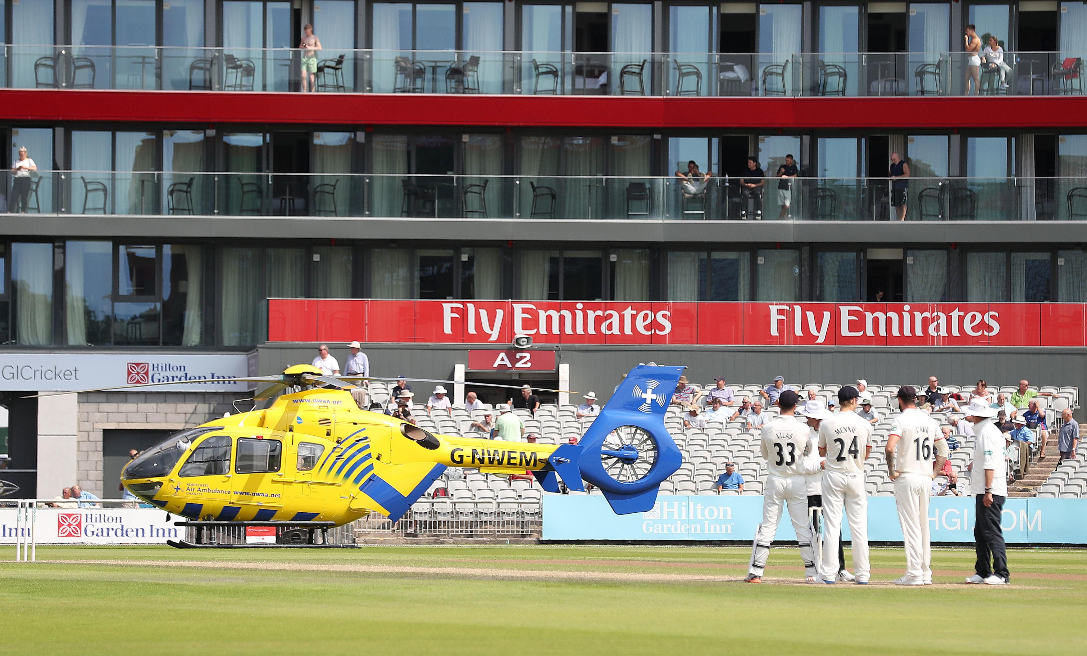 An air ambulance was forced to land at Old Trafford to help an ill fan
