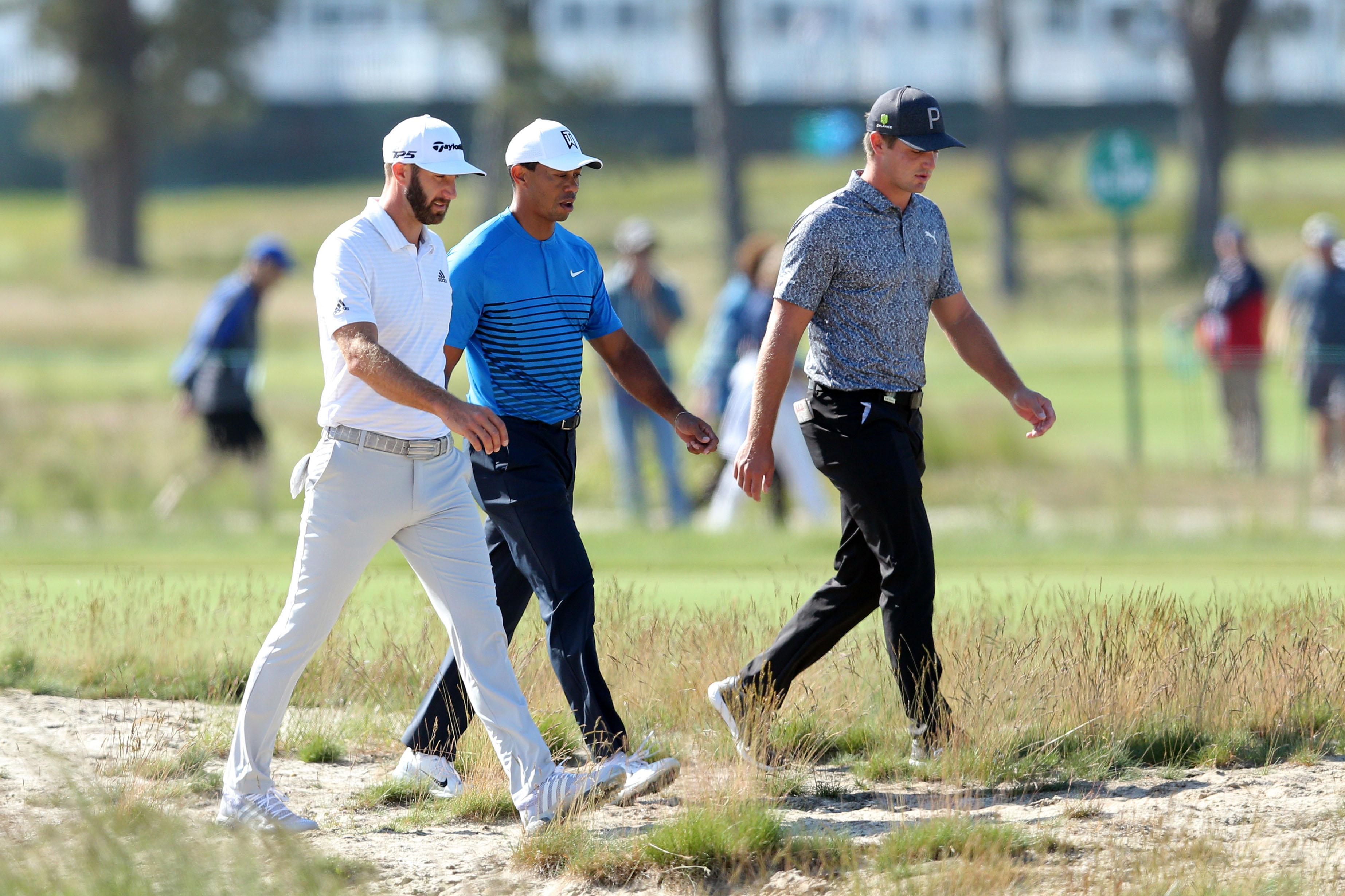 Woods completed his practice round alongside World No1 Dustin Johnson (left) and fellow American Bryson DeChambeau (right)