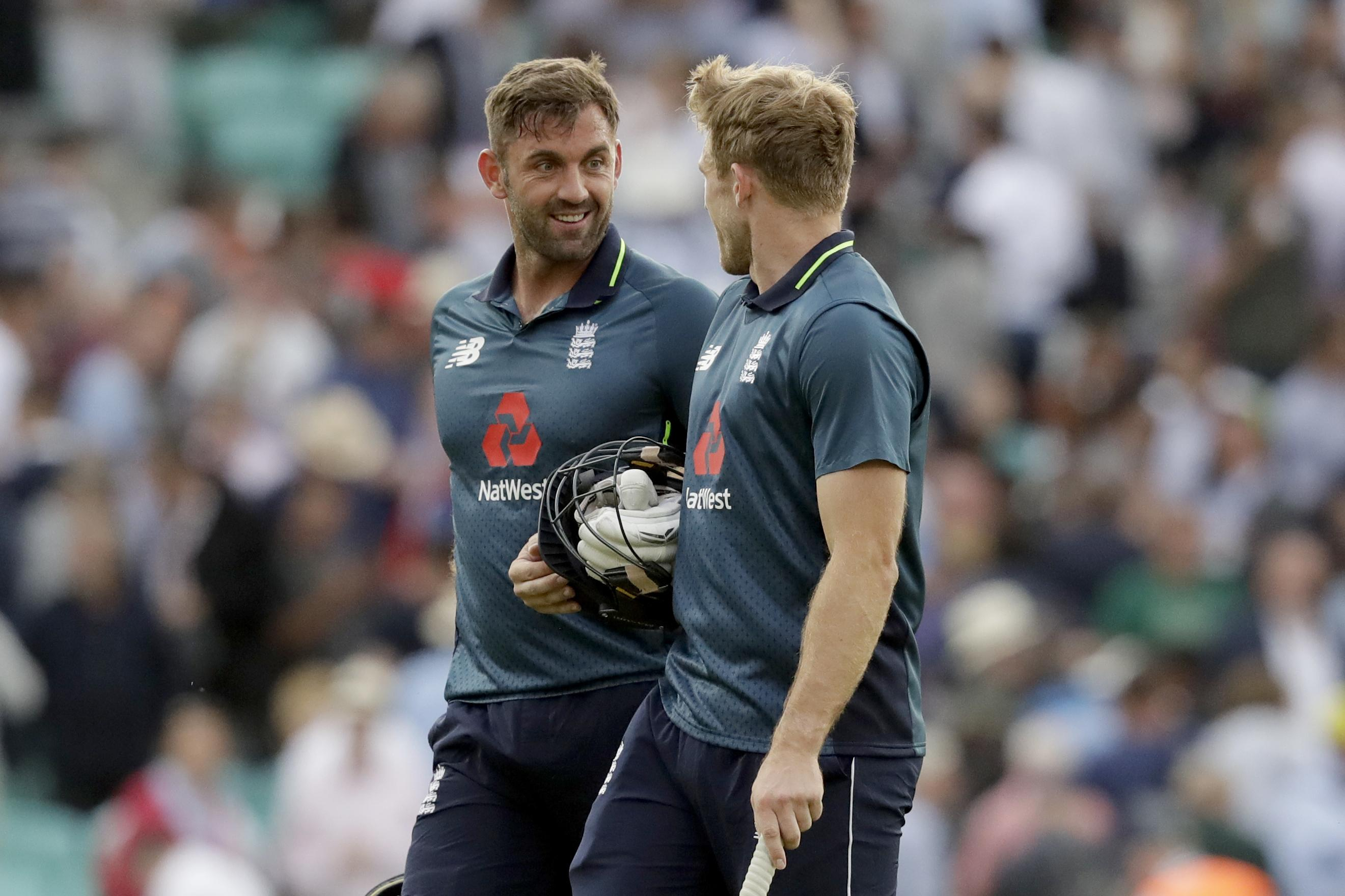 David Willey and Liam Plunkett celebrate after seeing England home