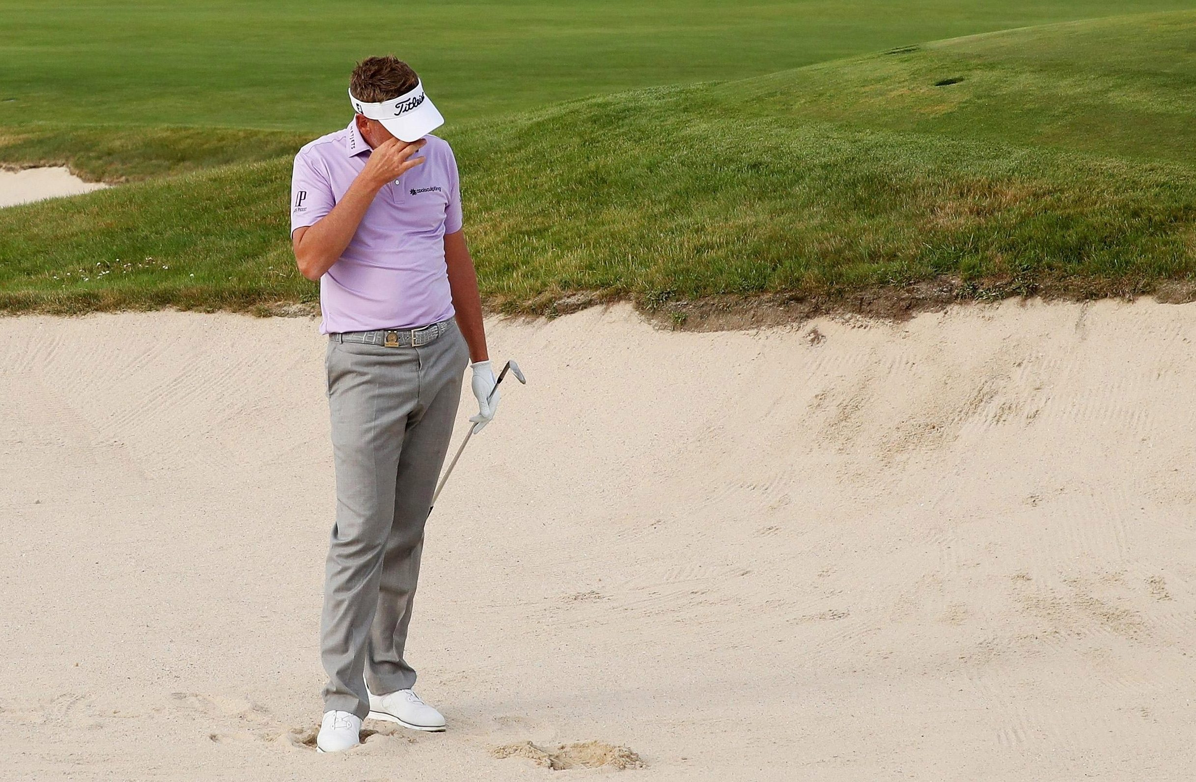 Ian Poulter had a late meltdown when he was just one shot off the lead