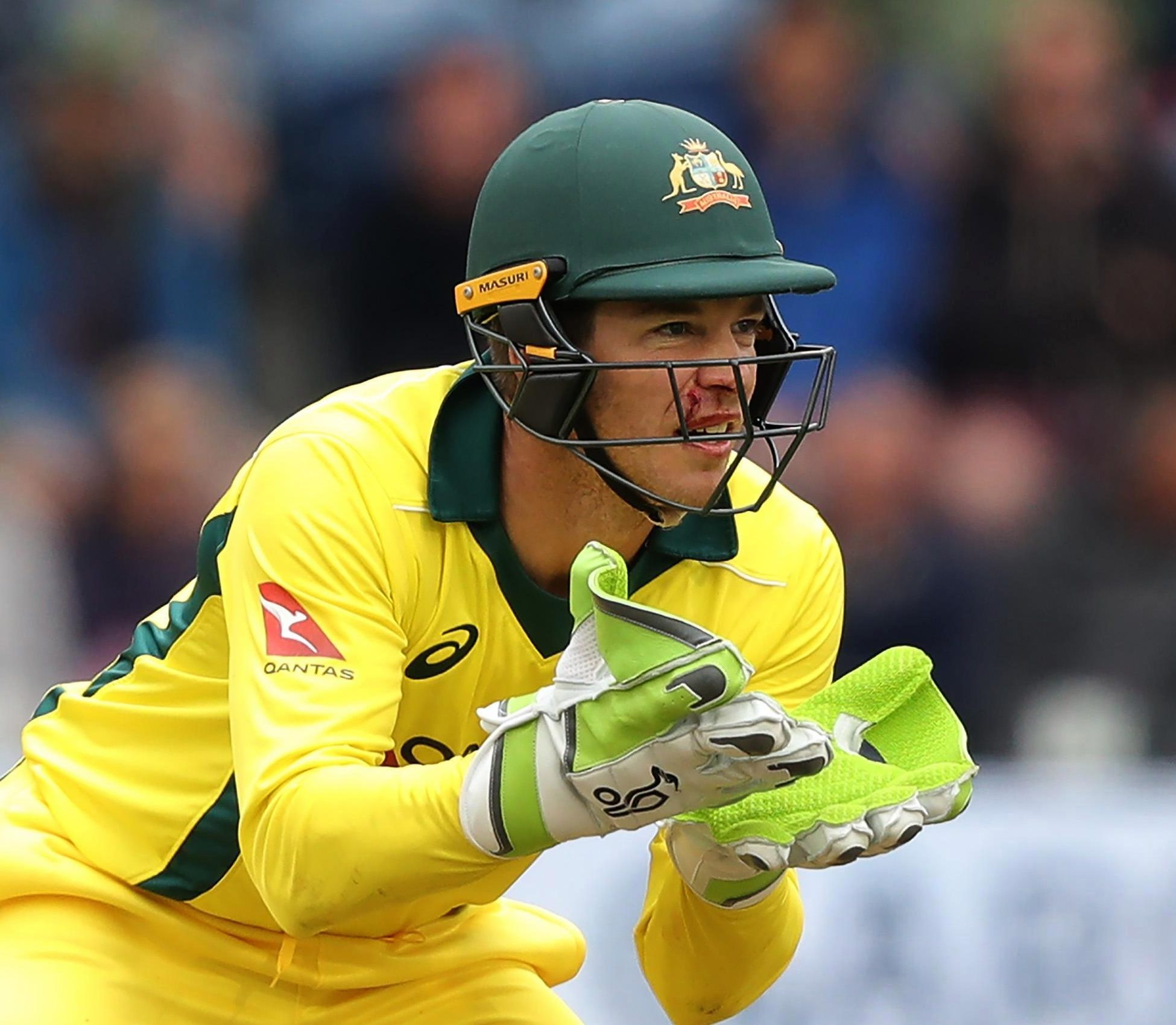 Tim Paine suffered a nasty blow after being hit in the face by an Andrew Tye ball