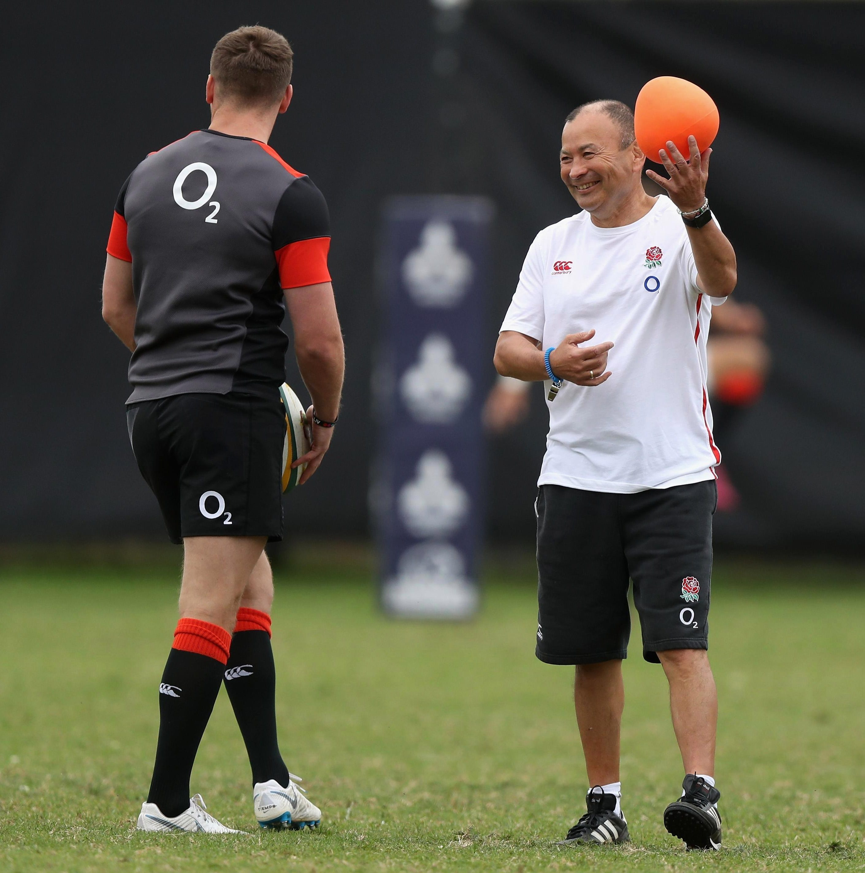 Eddie Jones smiles as he watches Owen Farrell in training at Durban
