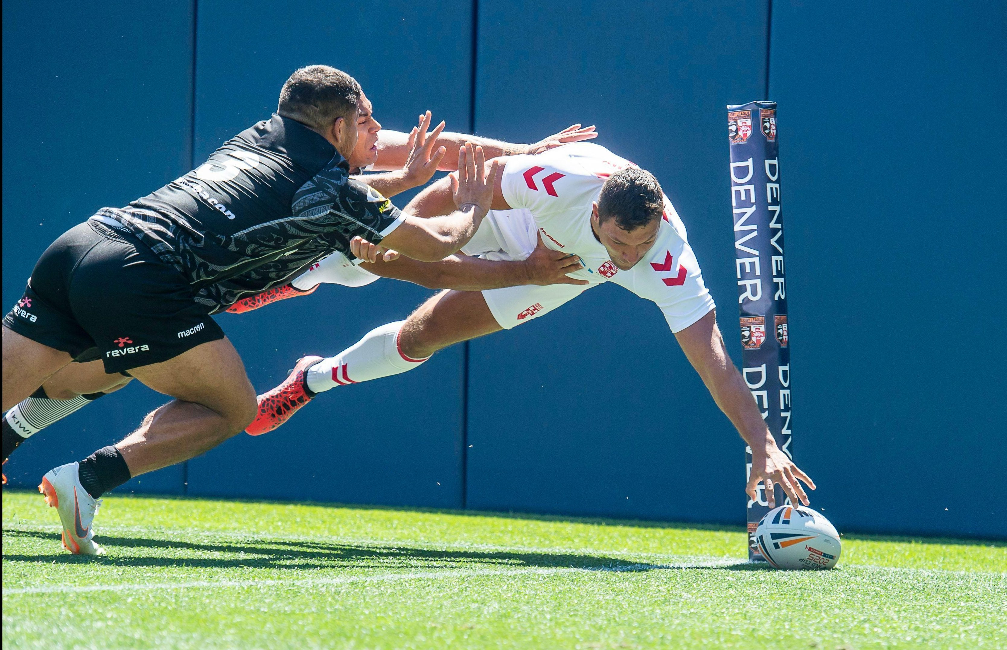 England winger Ryan Hall reaches to score a try during England's 36-18 win against New Zealand in the US