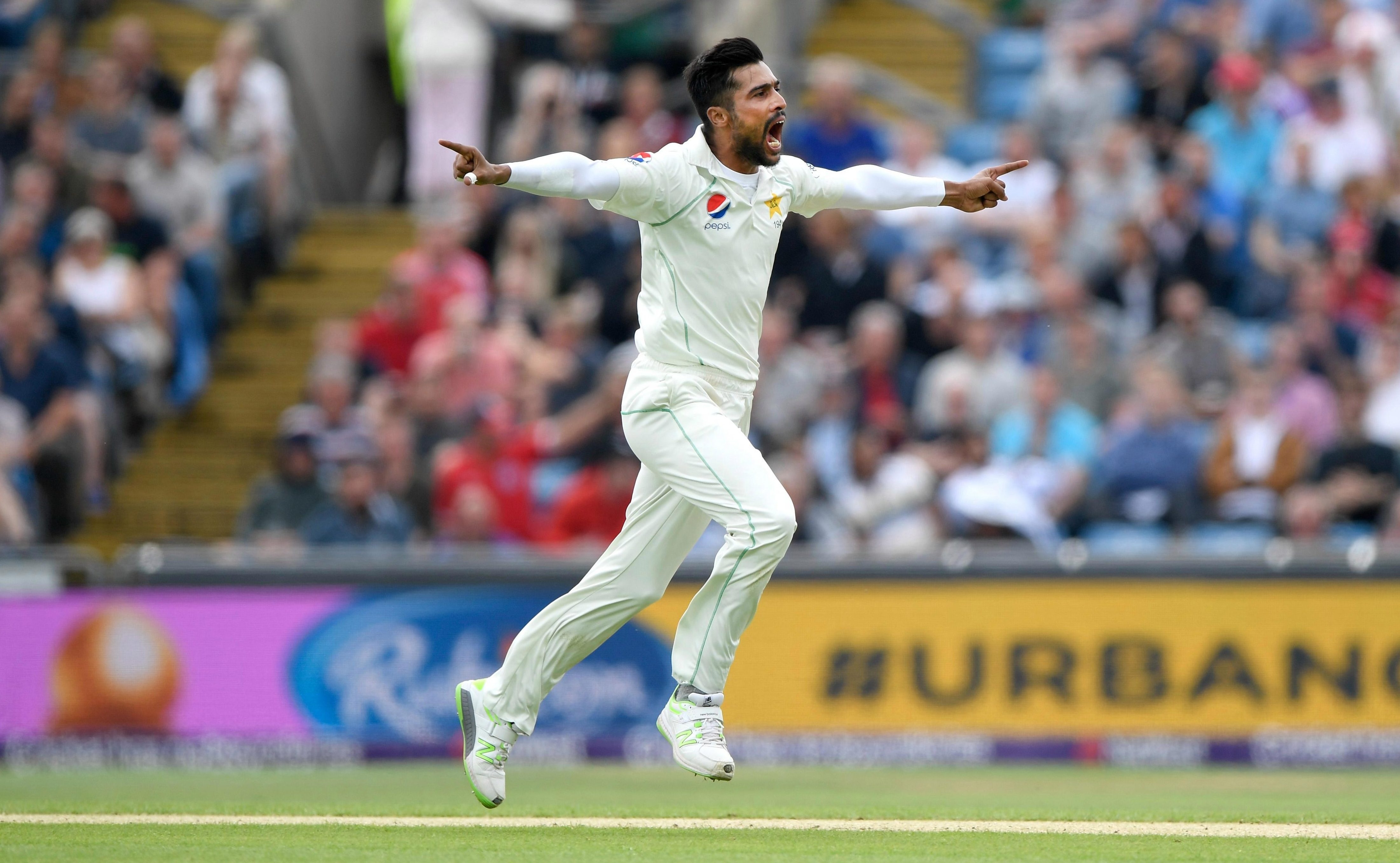 Mohammad Amir celebrates the wicket of Joe Root
