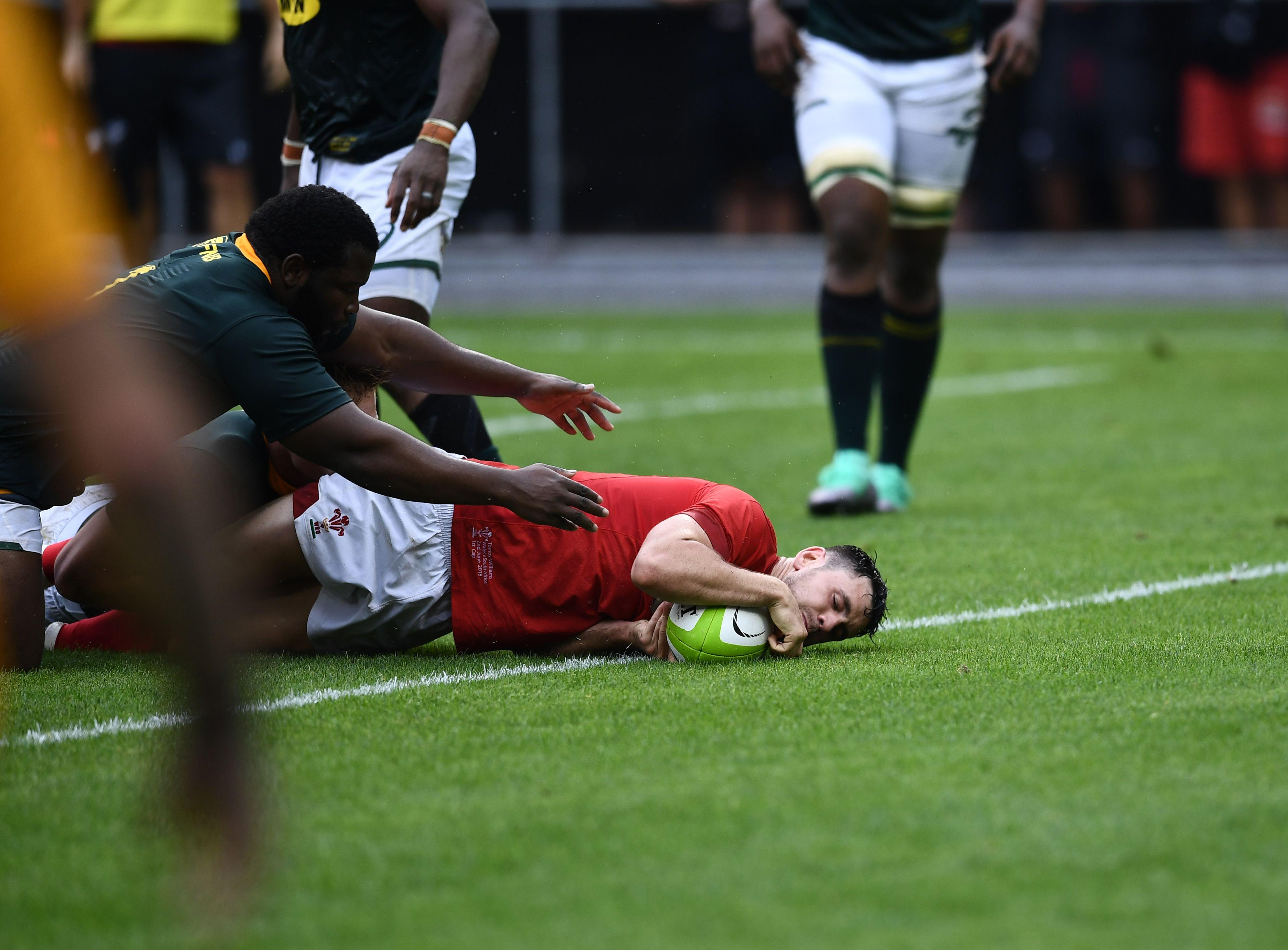 Tomos Williams goes over for Wales' second try on his international debut