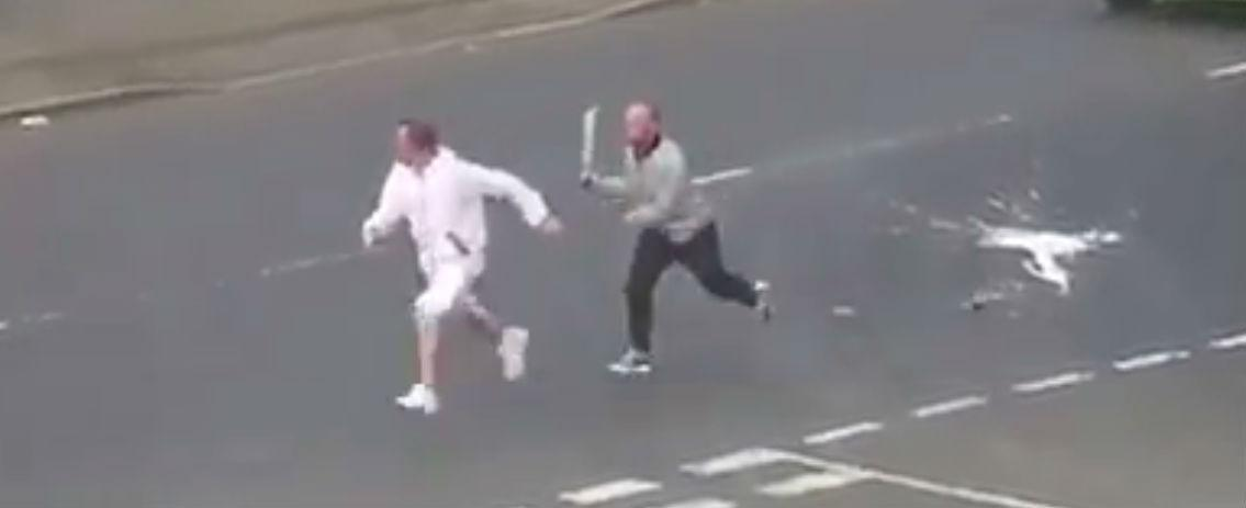 Shocking moment thug armed with SWORD chases man down ...