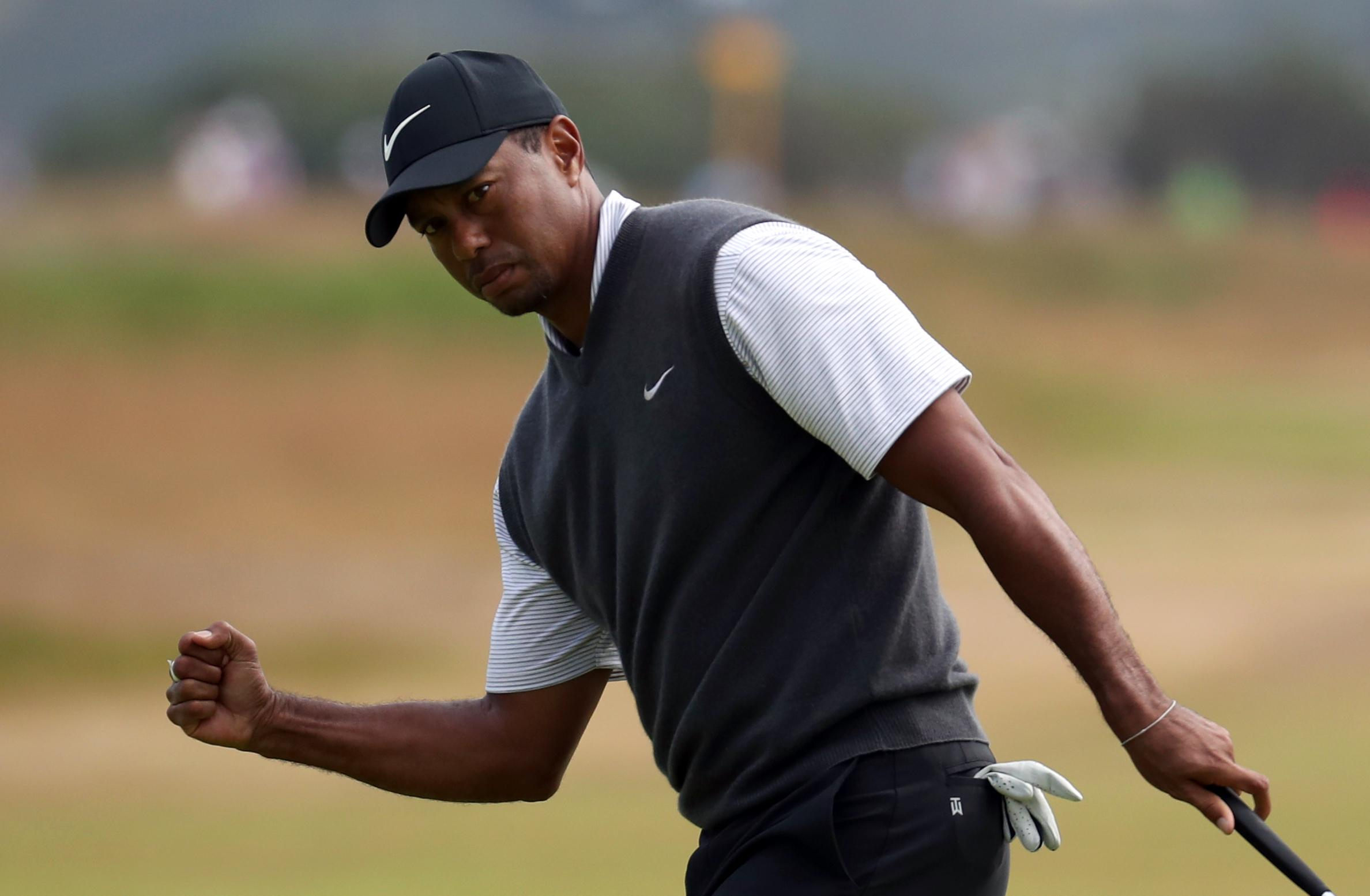 Tiger Woods lit up Carnoustie as he surged into contention