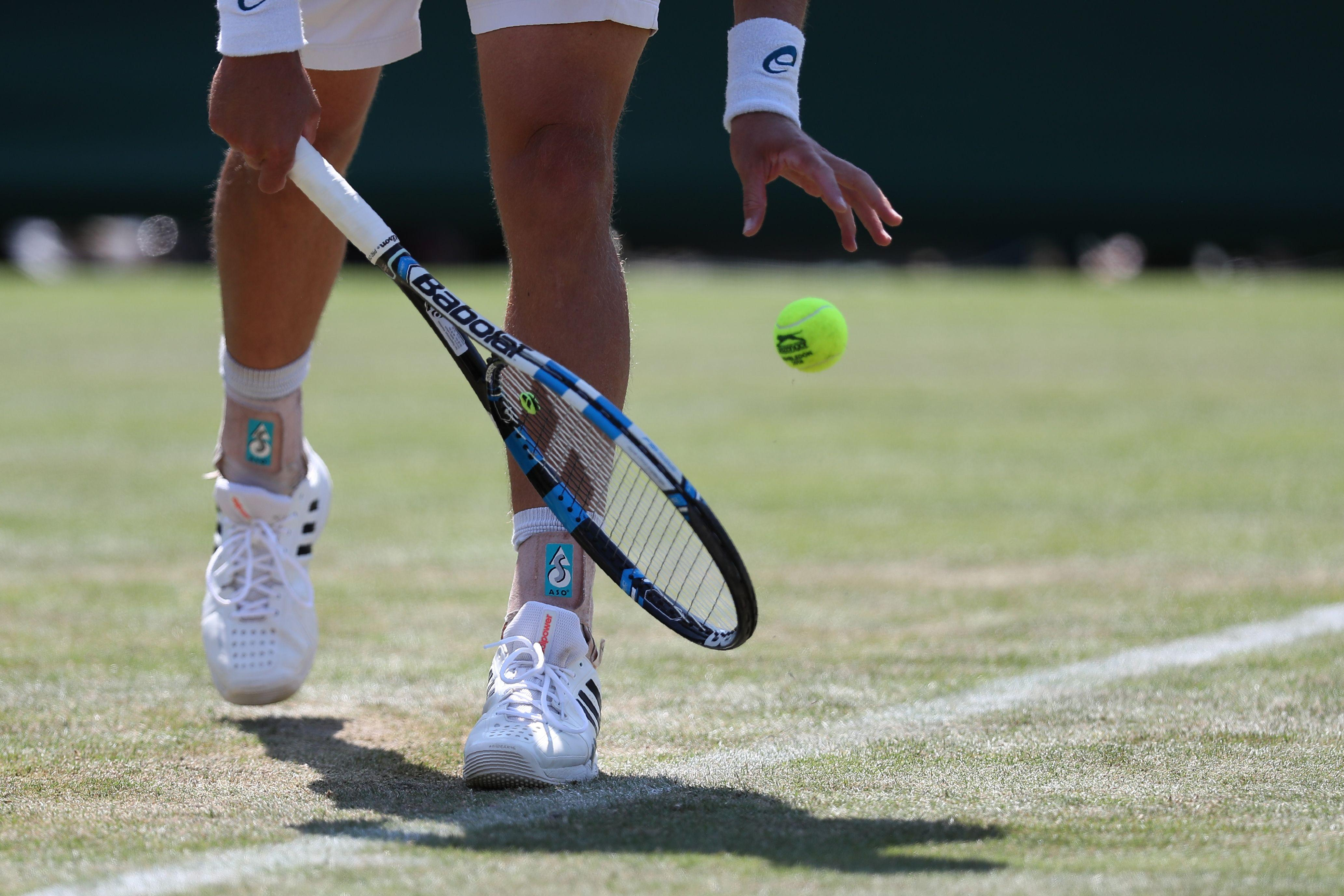 Is there a particular reason why tennis players bounce the ball before serving?