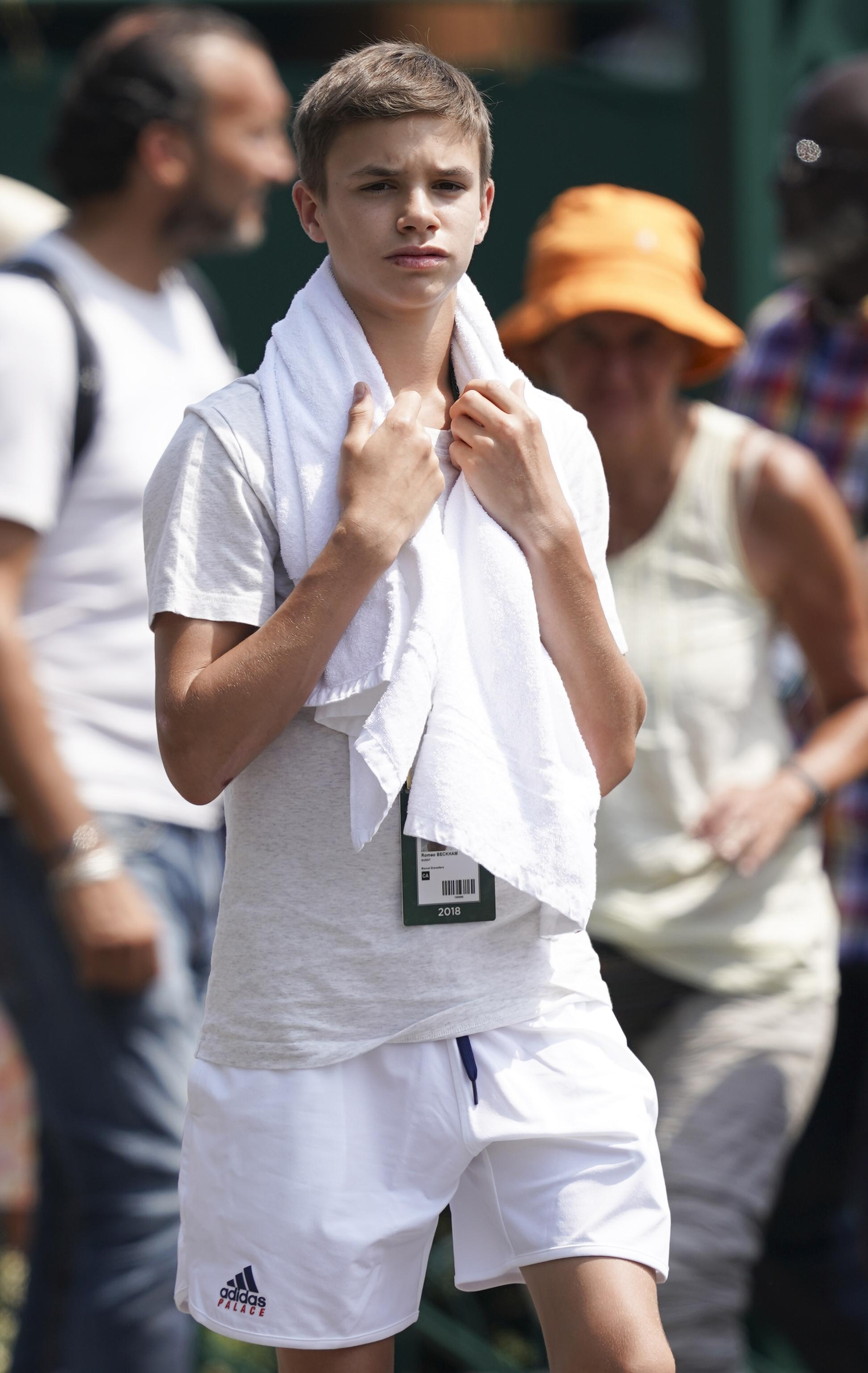 Romeo Beckham, 15, definitely hasn't thrown in the towel and still attends Wimbledon in the heatwave