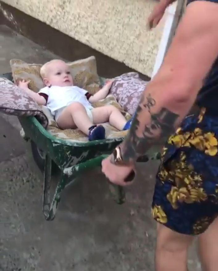 The UFC star seemed to think nothing of giving his lad a ride in a wheelbarrow