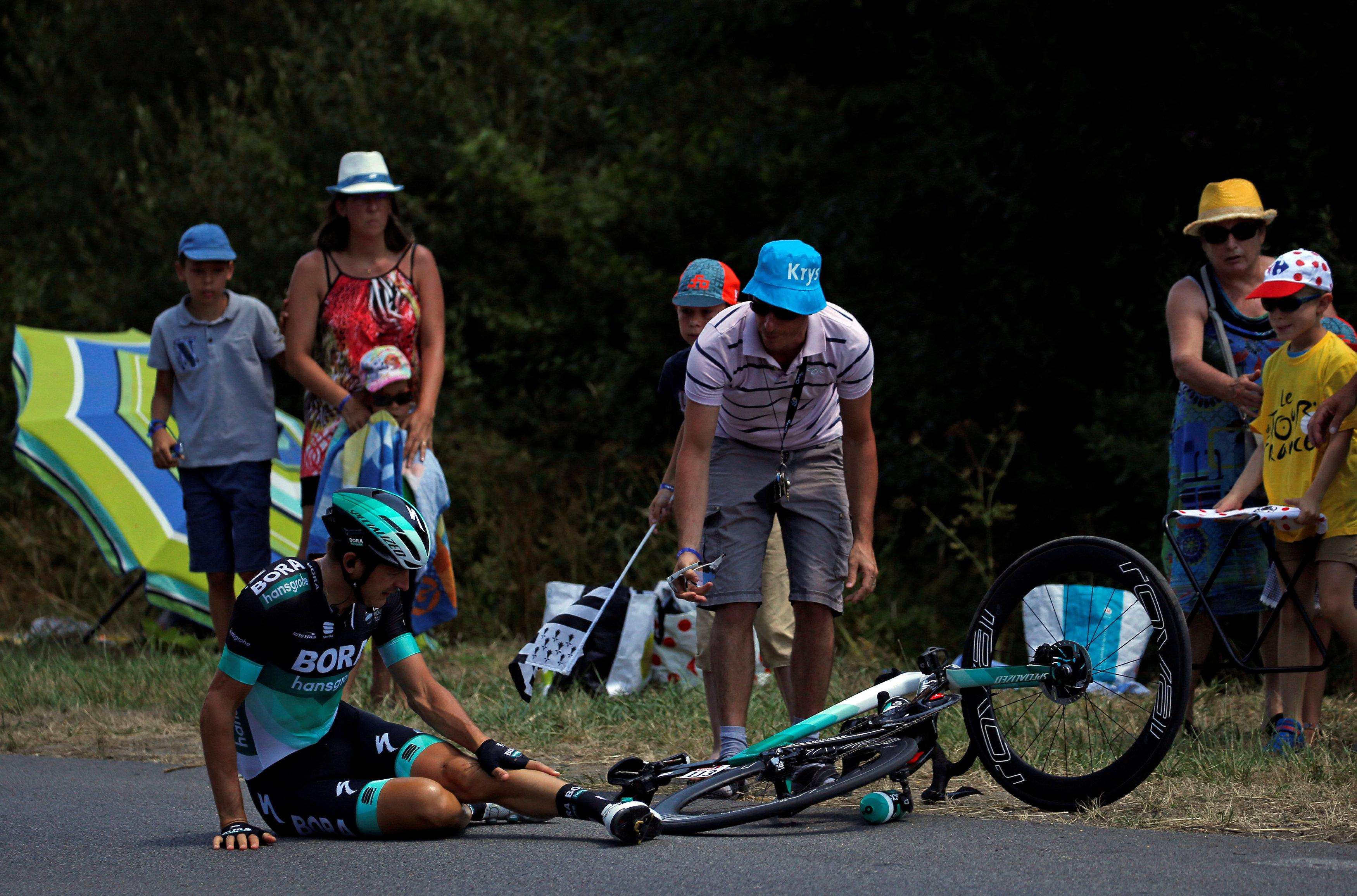 Several riders hit the deck with about three miles to go on stage four