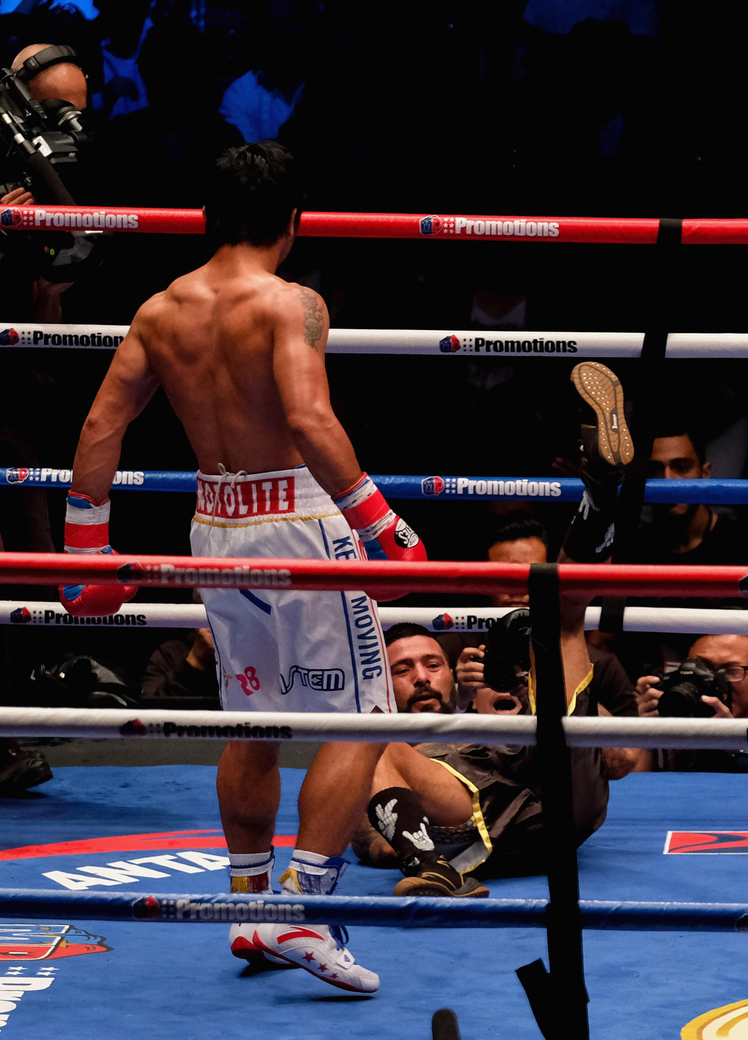 Argentine Matthysse was floored three times by the ruthless Pacquiao