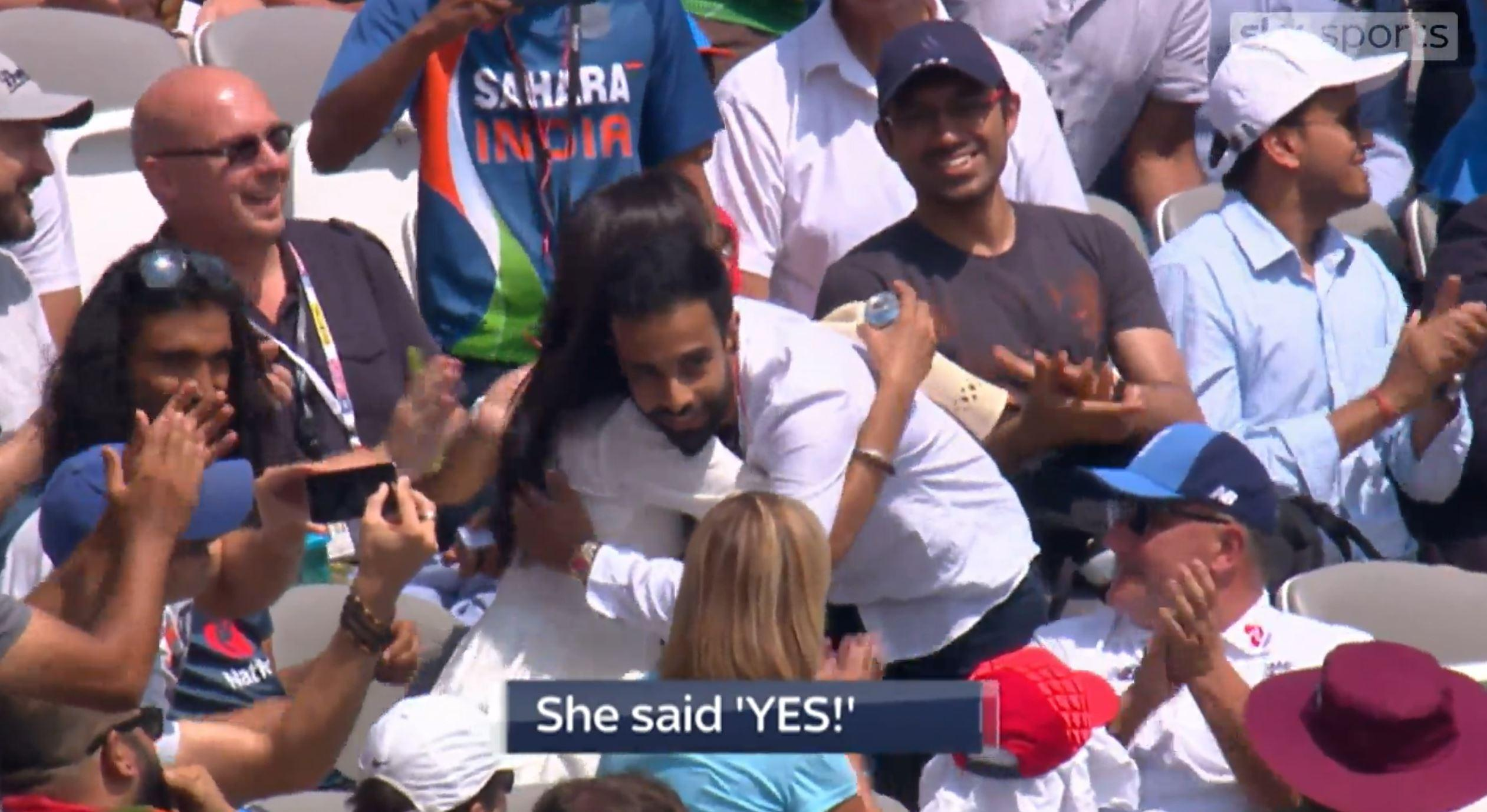 Charan Gills and Pavan Bains celebrate getting engaged at the cricket