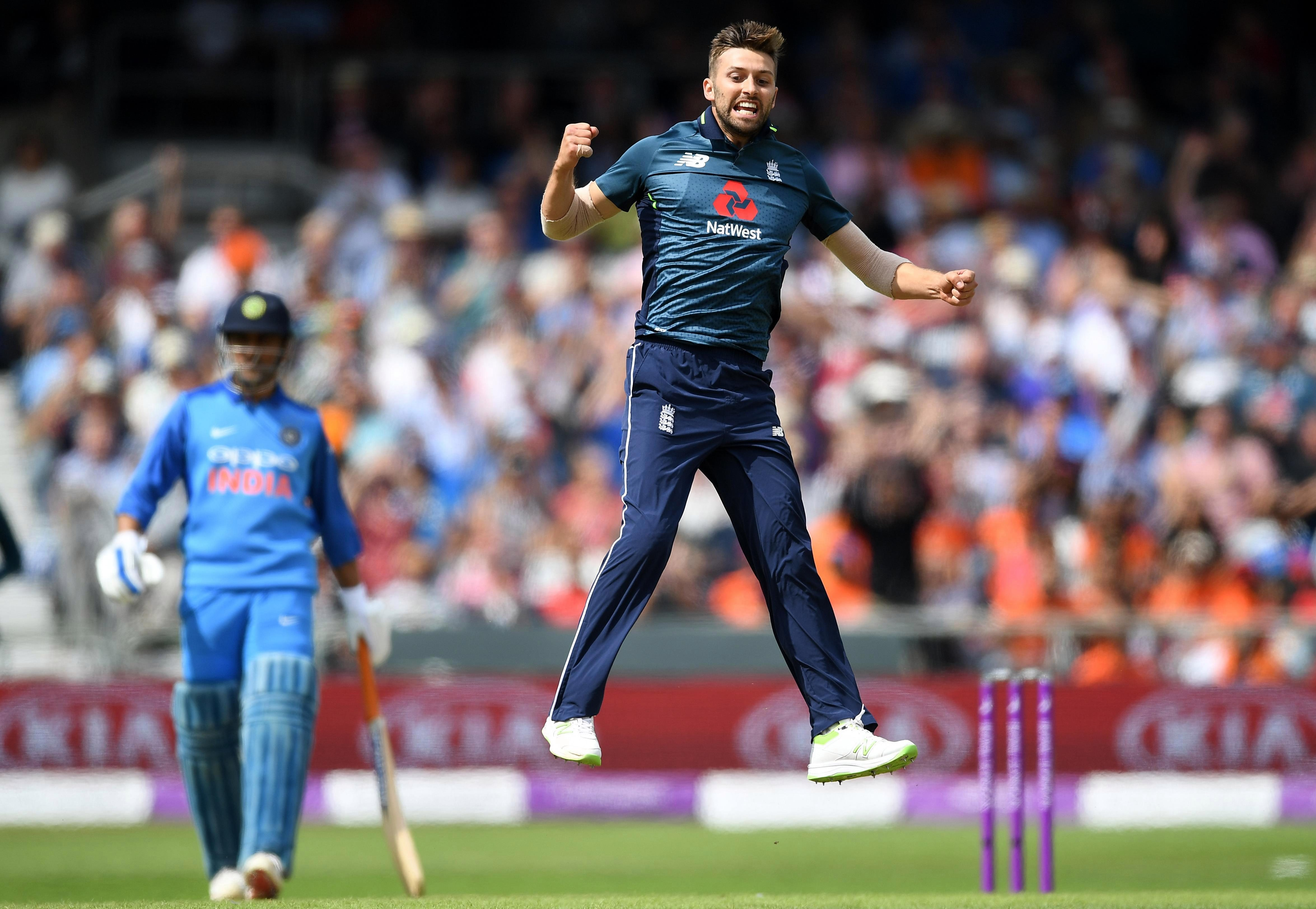 England fast bowler Mark Wood and Rashid both picked up three wickets