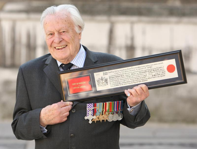 Geoffrey Wellum DFC, the youngest Spitfire pilot to fight in the Battle of Britain, holding his Freedom Certificate after receiving the Freedom of the City of London at the Guildhall, in central London